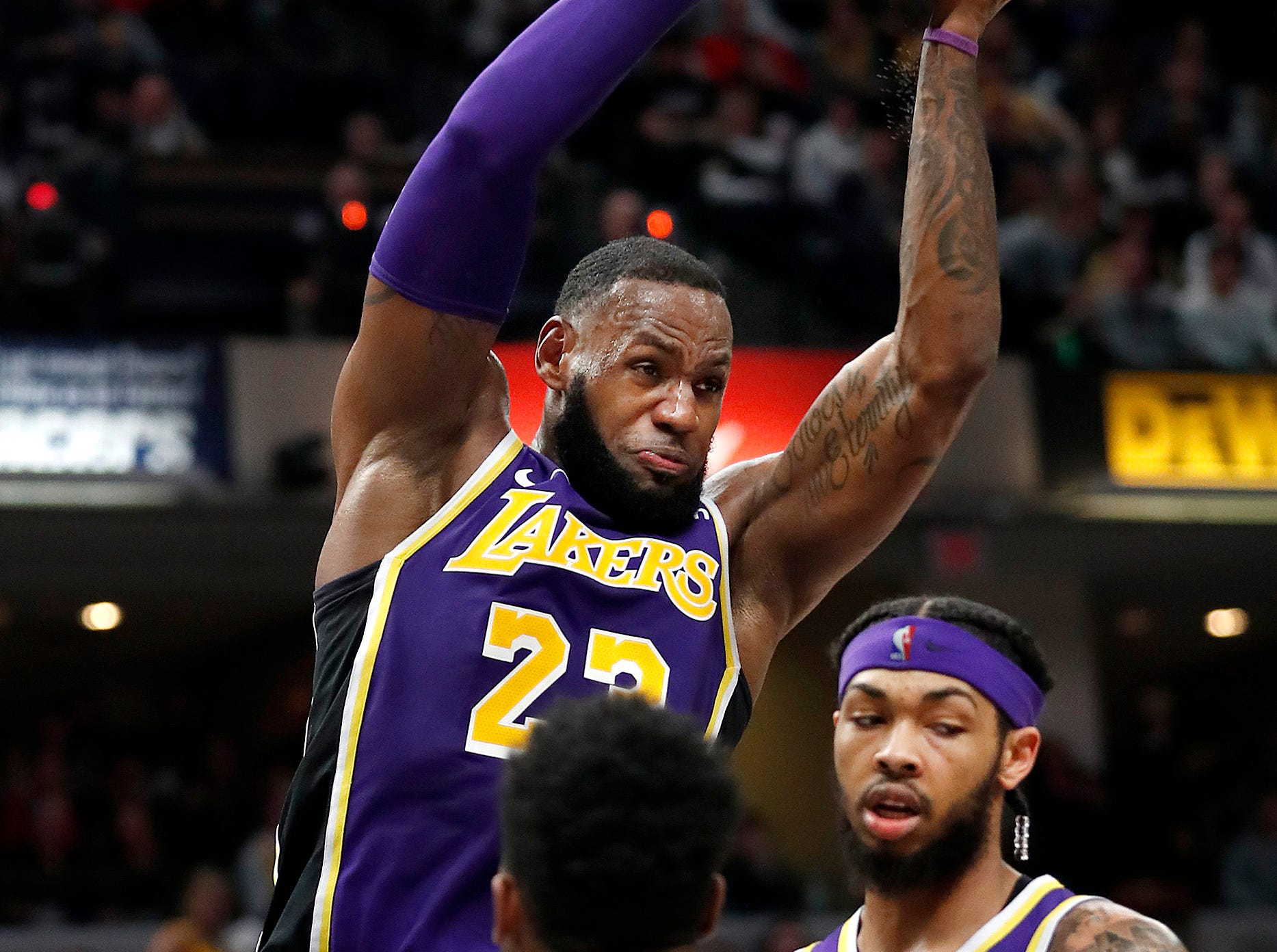 Los Angeles Lakers forward LeBron James (23) pulls down a rebound over Indiana Pacers forward Thaddeus Young (21) in the second half of their game at Bankers Life Fieldhouse on Tuesday, Feb. 5, 2019.