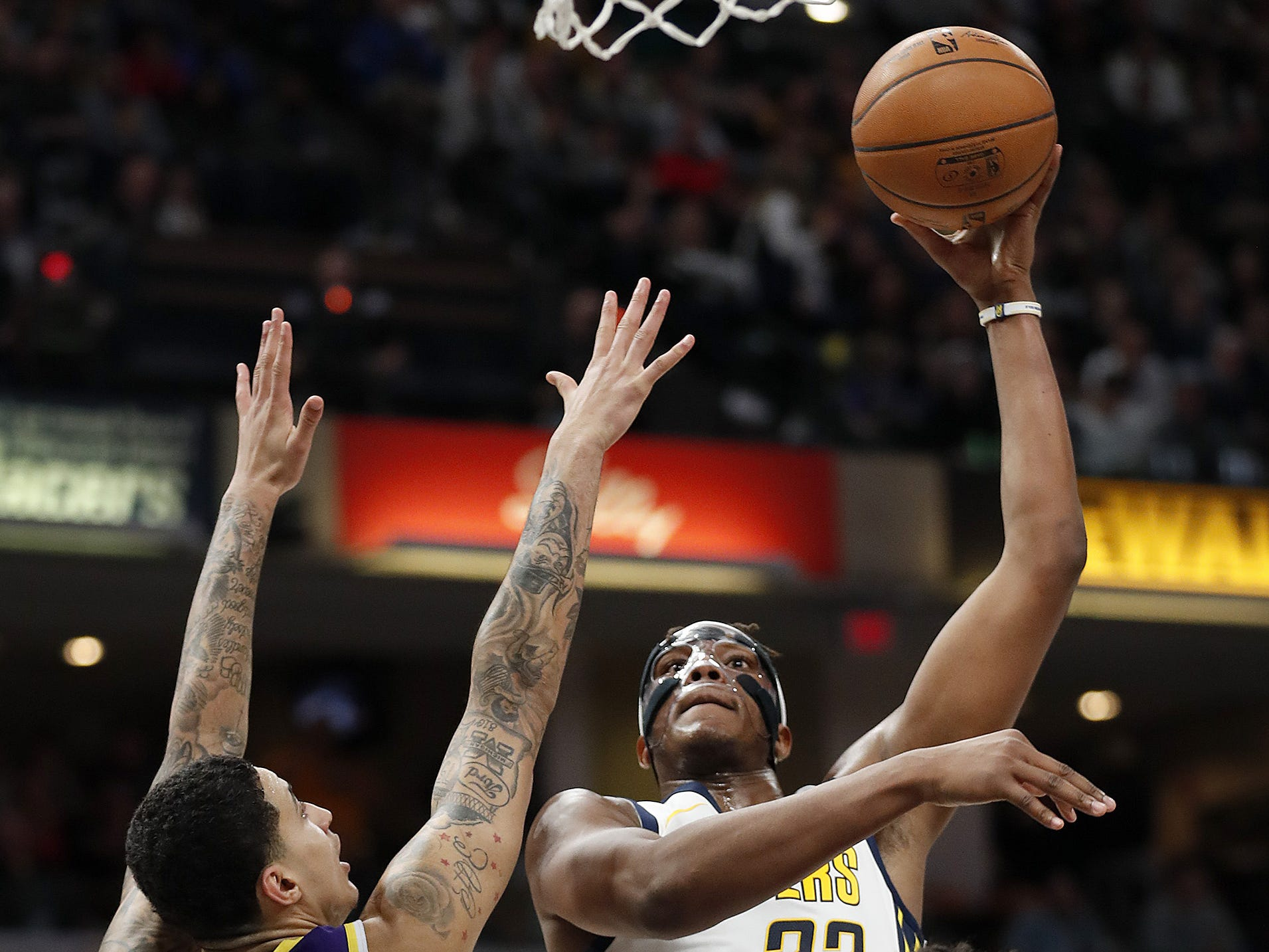 Indiana Pacers center Myles Turner (33) shoots over Los Angeles Lakers forward Kyle Kuzma (0) in the second half of their game at Bankers Life Fieldhouse on Tuesday, Feb. 5, 2019.
