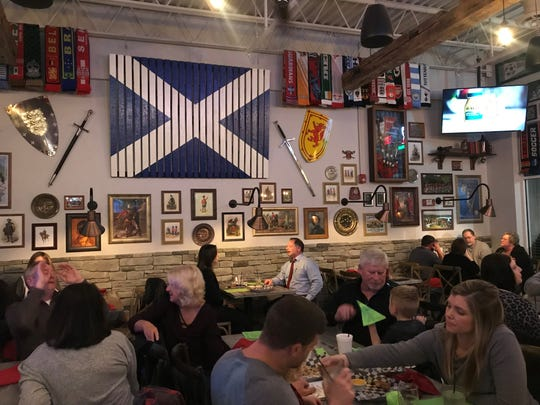Scotland's flag and swords, shields, prints and family mementos representing the country and its history decorate Campbell's Highland Grille in Greenwood.