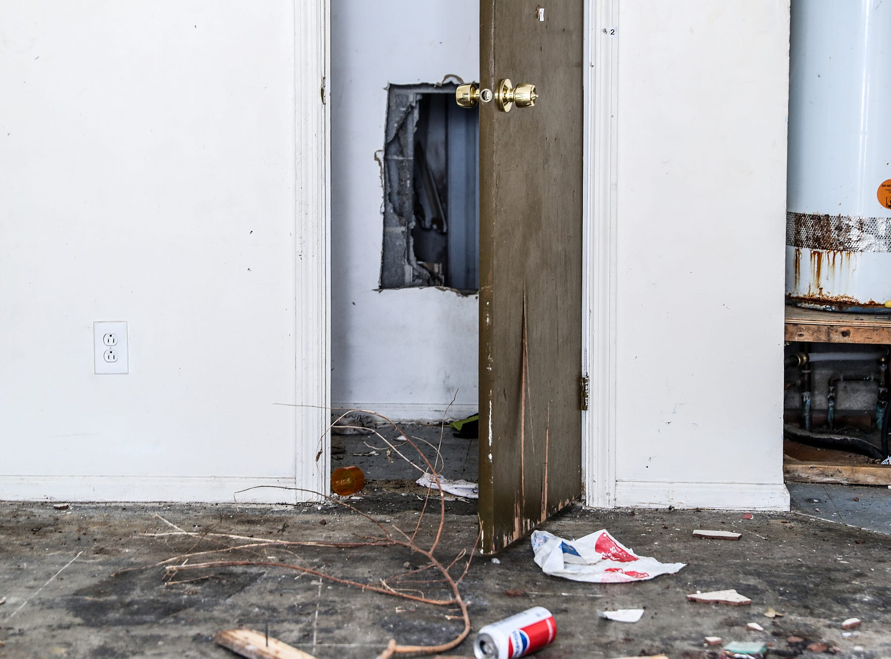 The scene inside an abandoned unit on Essex Court where the body of Anthony Eldridge was found in June 2018, at the Towne and Terrace housing complex off of 42nd Street and Post Road, Saturday, Dec. 8, 2018. At one point, a camera was mounted on the back of the building to keep watch for police entering the complex.