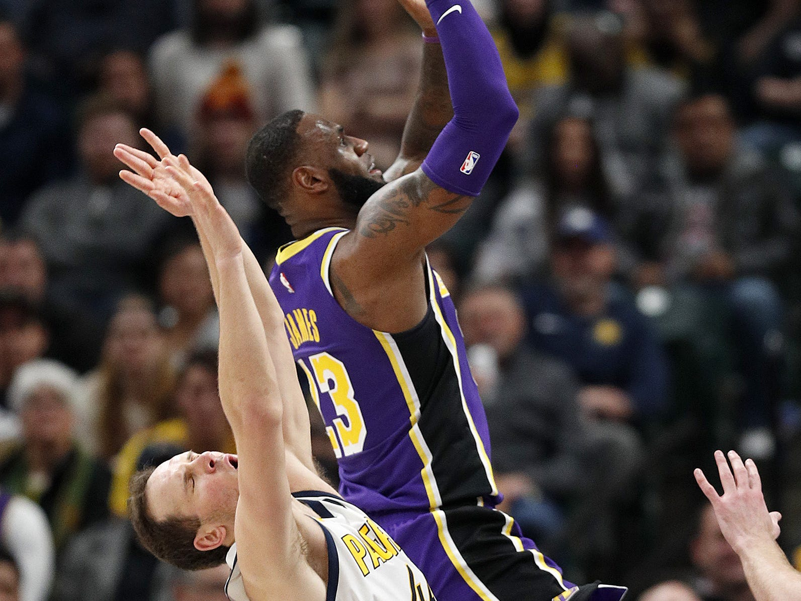 Los Angeles Lakers forward LeBron James (23) shoots over Indiana Pacers forward Bojan Bogdanovic (44) in the first half of their game at Bankers Life Fieldouse on Tuesday, Feb. 5, 2019.