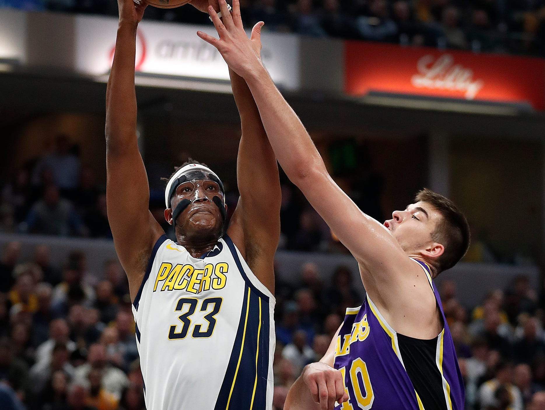 Indiana Pacers center Myles Turner (33) shoots over Los Angeles Lakers center Ivica Zubac (40) in the first half of their game at Bankers Life Fieldhouse on Tuesday, Feb. 5, 2019.