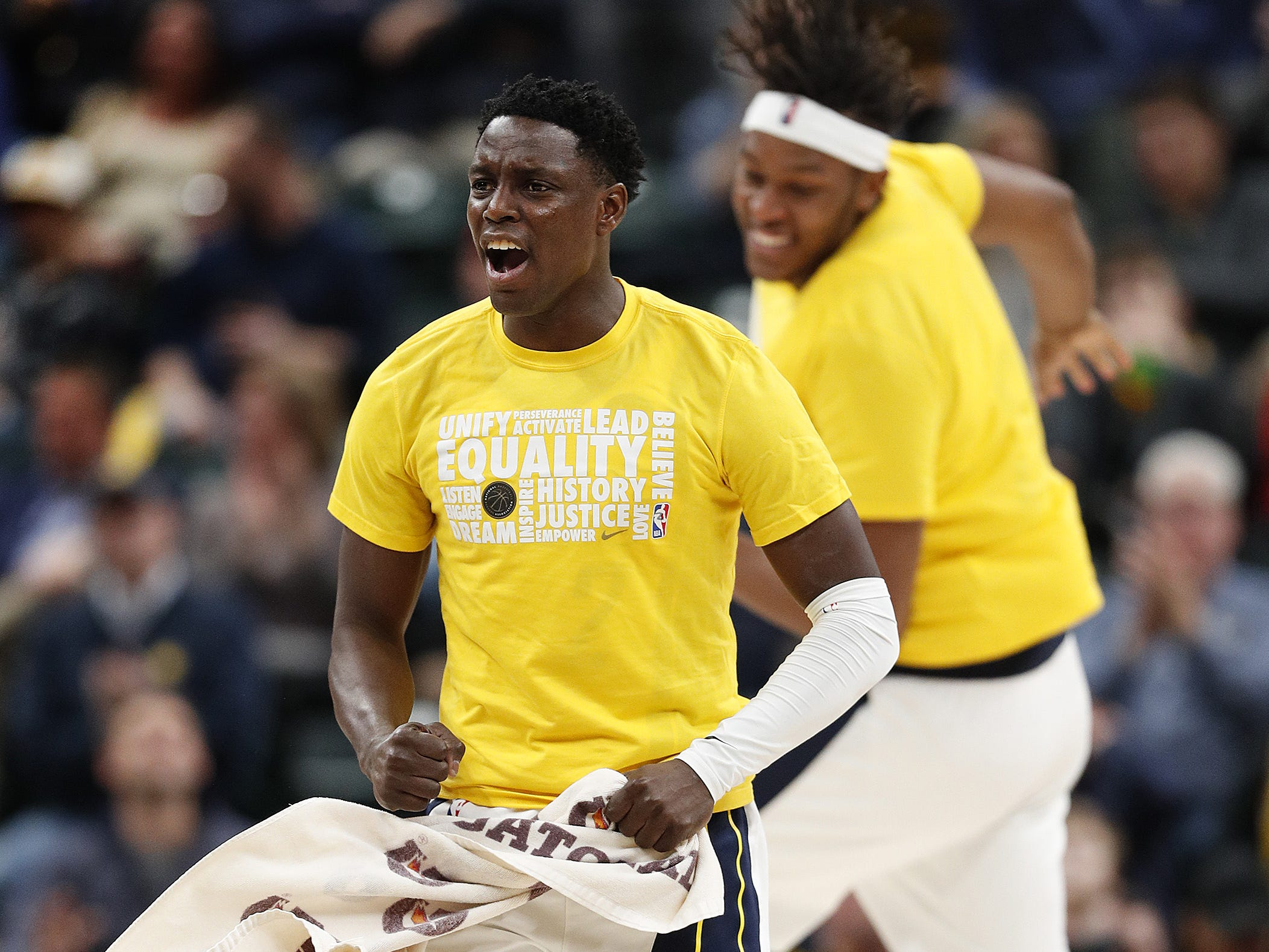 Indiana Pacers guard Darren Collison (2) jumps off the bench to celebrate with his teammates late in the second half of their game at Bankers Life Fieldhouse on Tuesday, Feb. 5, 2019.