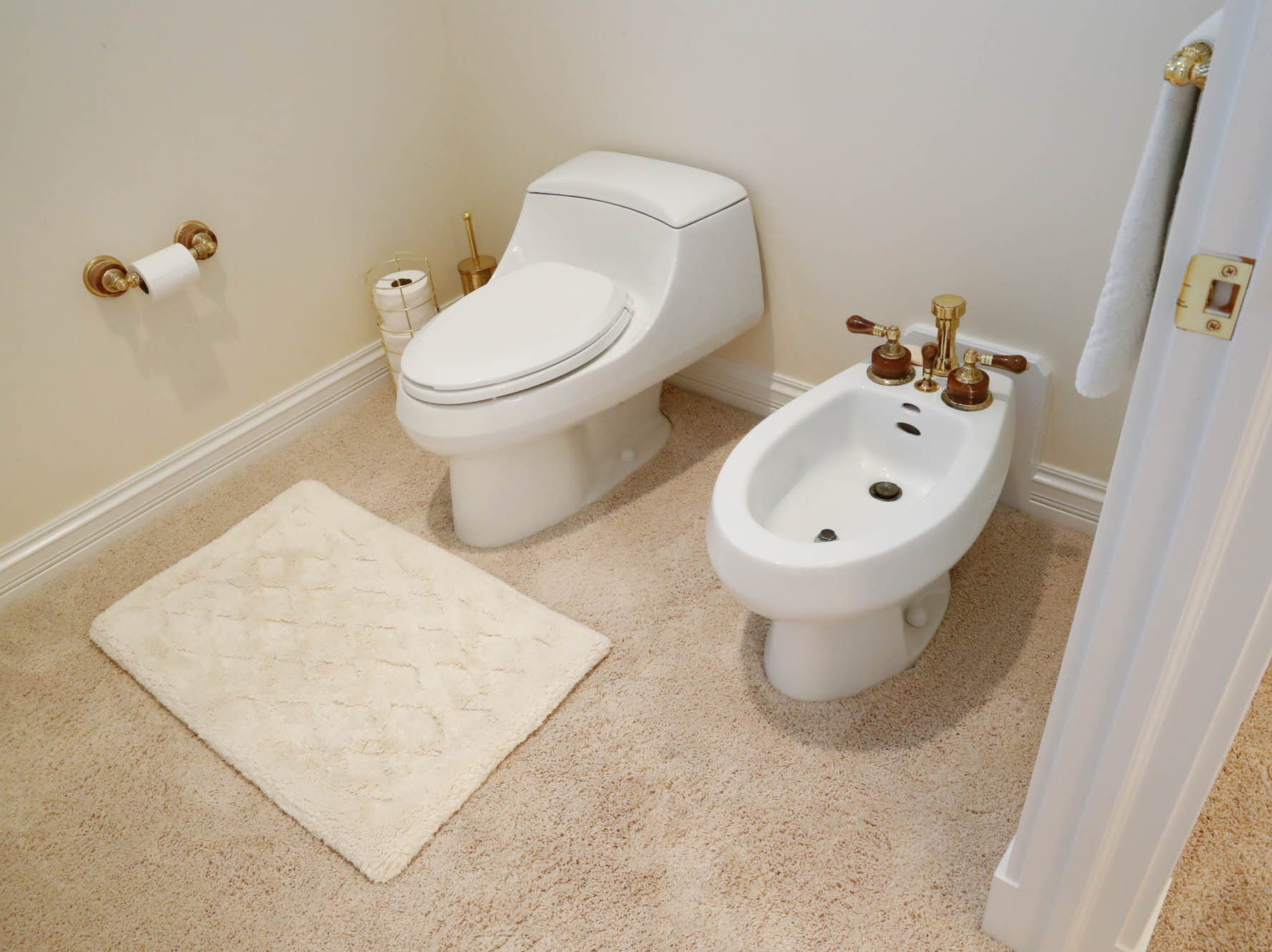 A bathroom features a bidet with gold accents at a Greenwood home up for sale at 1216 Stone Ridge Court, Greenwood, Ind. on Wednesday, Jan. 30, 2019. The home features 8,234 square feet, four bedrooms, two master suits, a 10 car garage, and exercise room.