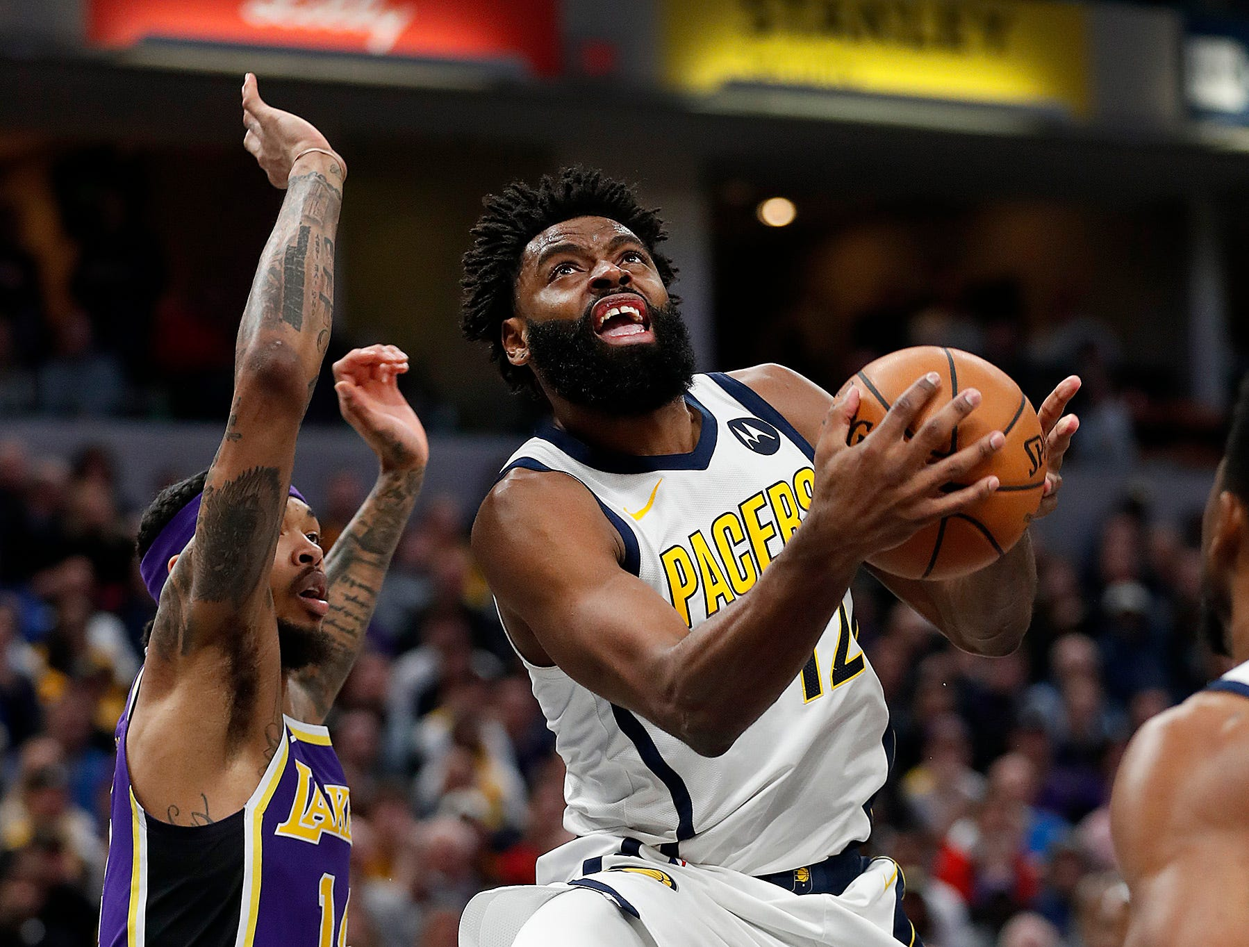 Indiana Pacers guard Tyreke Evans (12) drives on Los Angeles Lakers forward Brandon Ingram (14) in the first half of their game at Bankers Life Fieldhouse on Tuesday, Feb. 5, 2019.