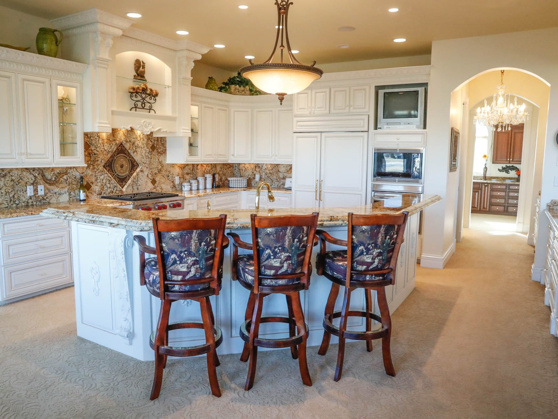 A Greenwood home up for sale at 1216 Stone Ridge Court, Greenwood, Ind., features a large kitchen with breakfast bar, butters pantry, and lots of storage, on Wednesday, Jan. 30, 2019. The home features 8,234 square feet, four bedrooms, two master suits, a 10 car garage, and exercise room.