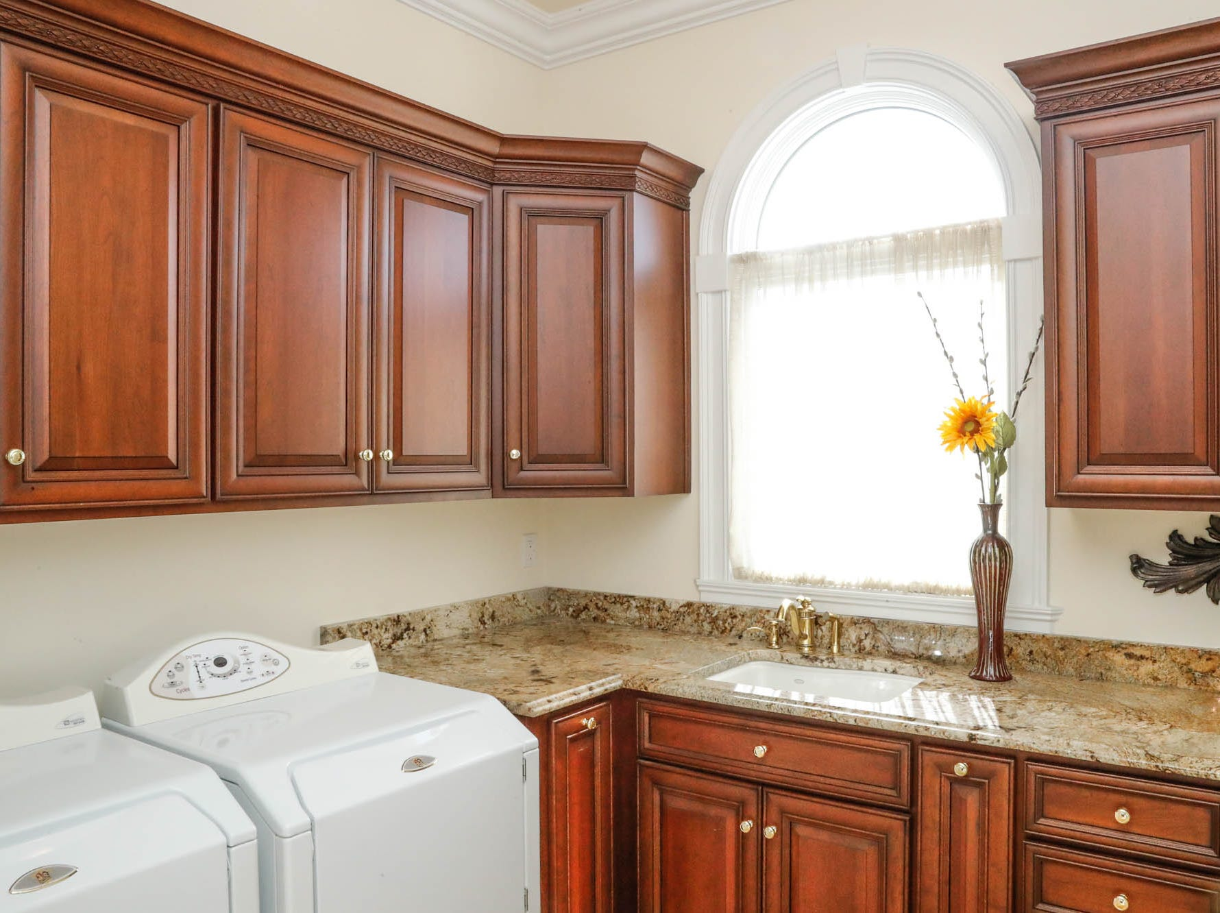 One of two laundry spaces features a rounded window at a Greenwood home up for sale at 1216 Stone Ridge Court, Greenwood, Ind. on Wednesday, Jan. 30, 2019. The home features 8,234 square feet, four bedrooms, two master suits, a 10 car garage, and exercise room.