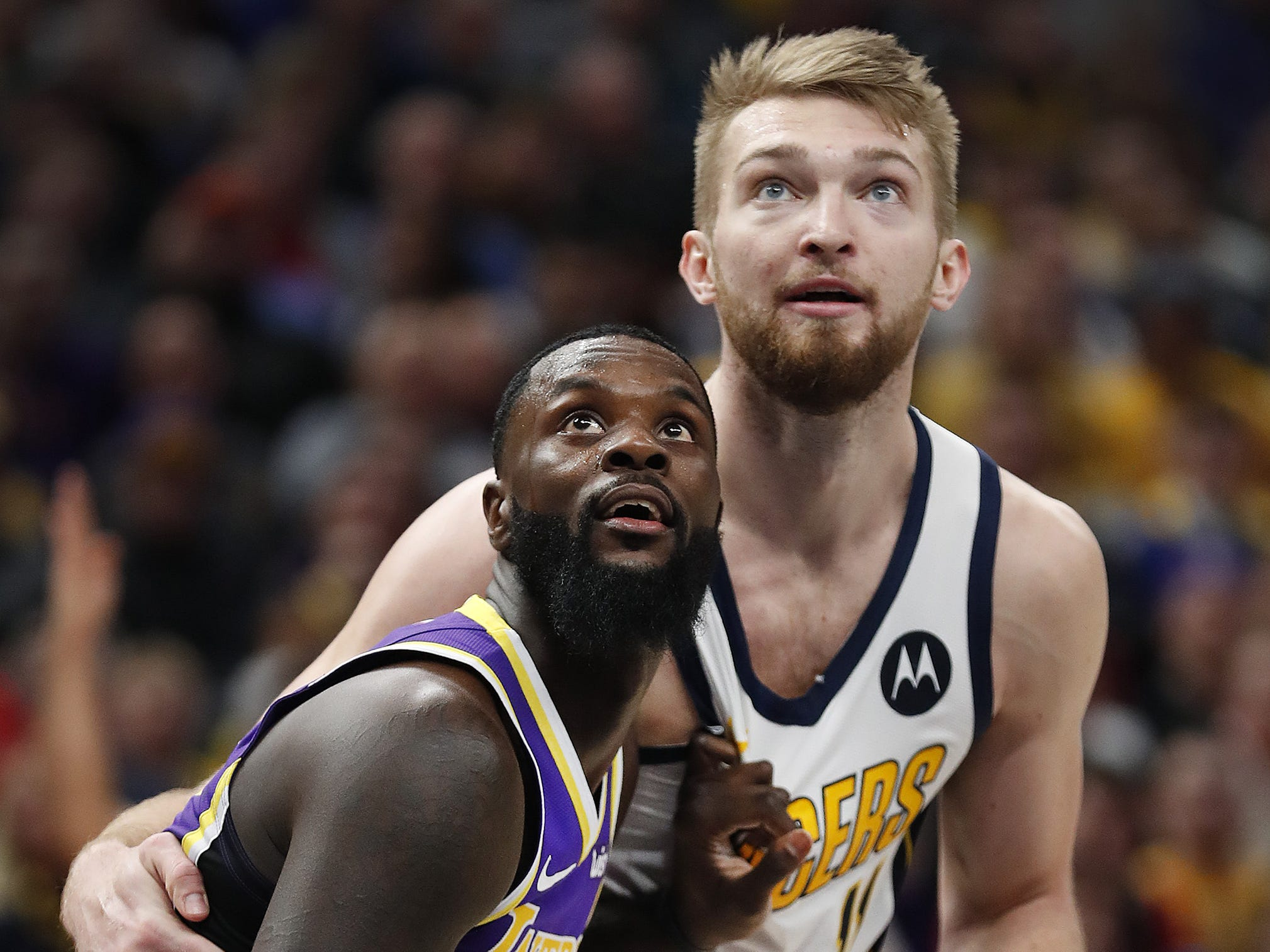 Indiana Pacers forward Domantas Sabonis (11) and Los Angeles Lakers guard Lance Stephenson (6) box out each other late in the second half of their game at Bankers Life Fieldhouse on Tuesday, Feb. 5, 2019.