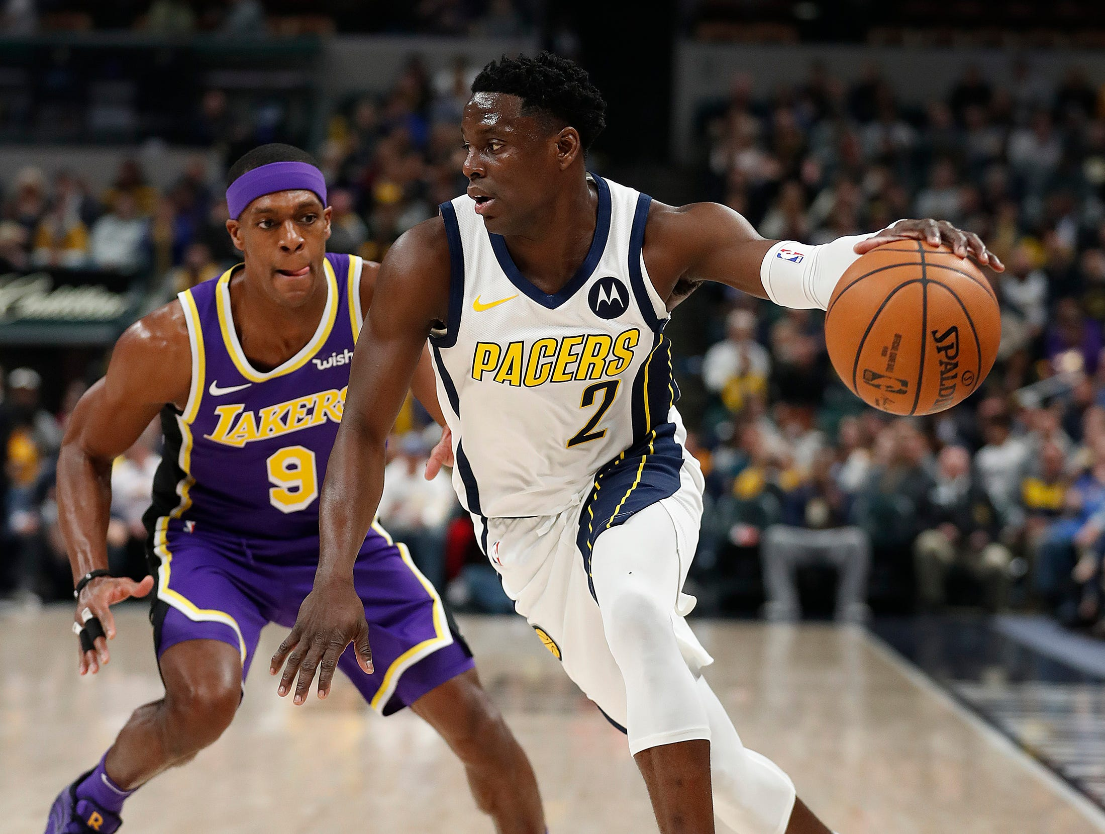 Indiana Pacers guard Darren Collison (2) drives on Los Angeles Lakers guard Rajon Rondo (9) in the first half of their game at Bankers Life Fieldhouse on Tuesday, Feb. 5, 2019.