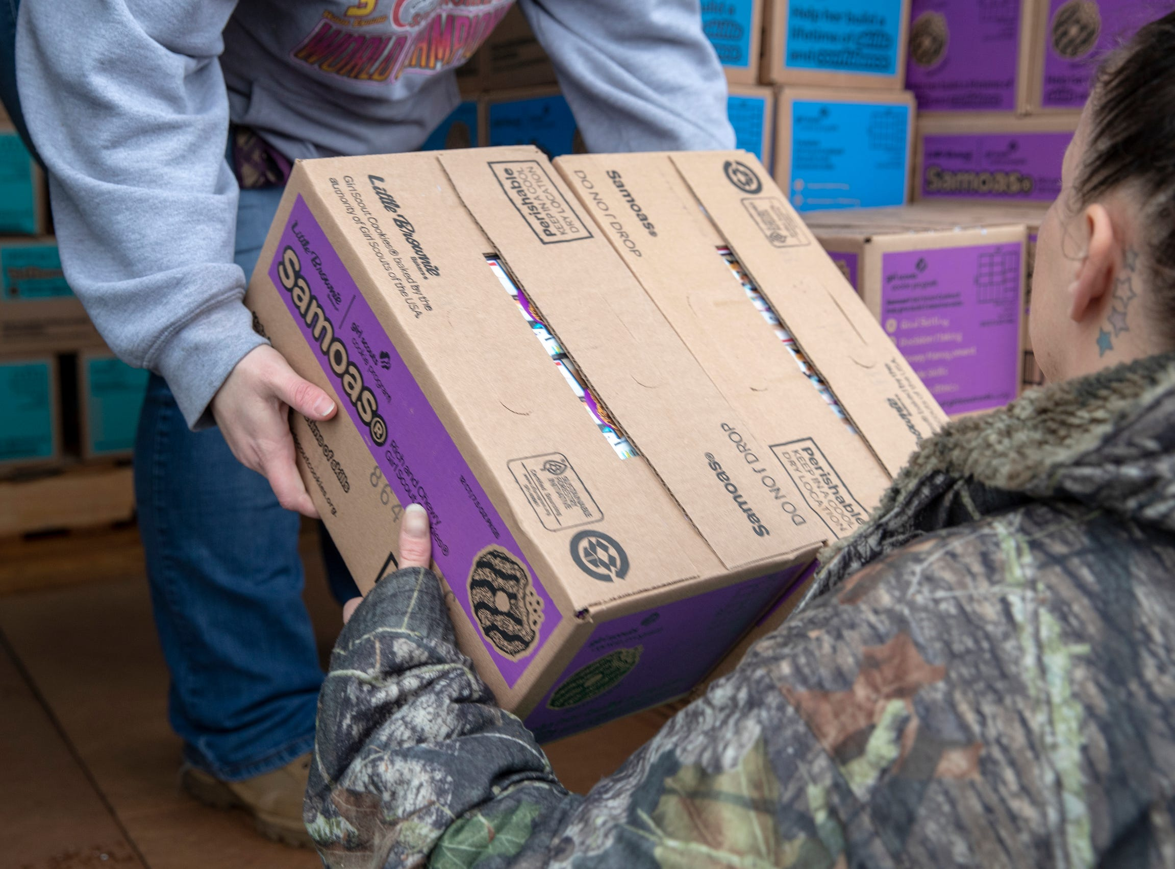 Samoas being loaded up into a car during distribution for Girl Scout Cookies in Indianapolis, Wednesday, Feb. 6, 2019. The cookies will start to appear locally on the weekend, and should last into mid-March.