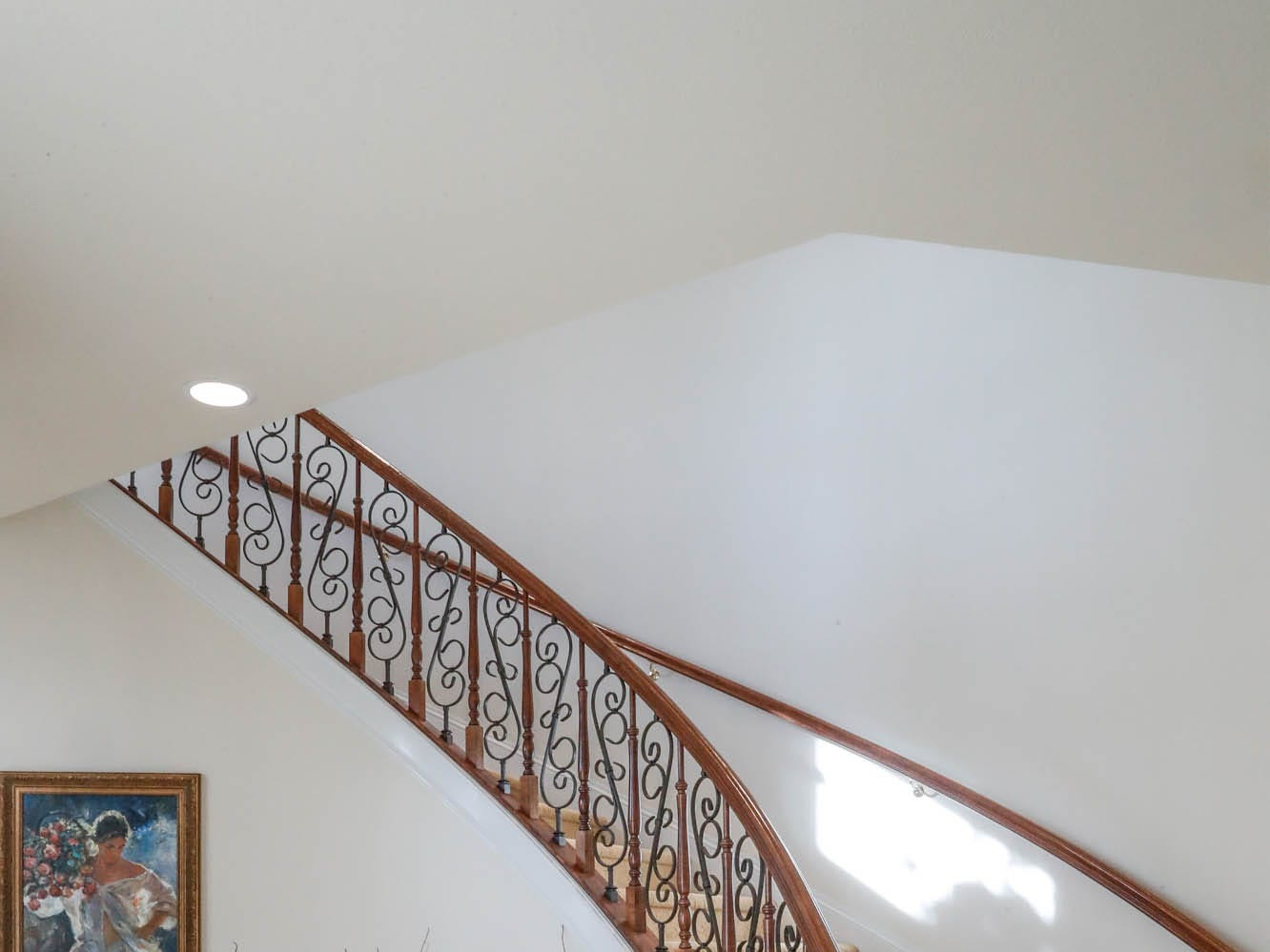 A winding grand staircase leads guests up to a, open game room at a Greenwood home up for sale at 1216 Stone Ridge Court, Greenwood, Ind. on Wednesday, Jan. 30, 2019. The home features 8,234 square feet, four bedrooms, two master suits, a 10 car garage, and exercise room.