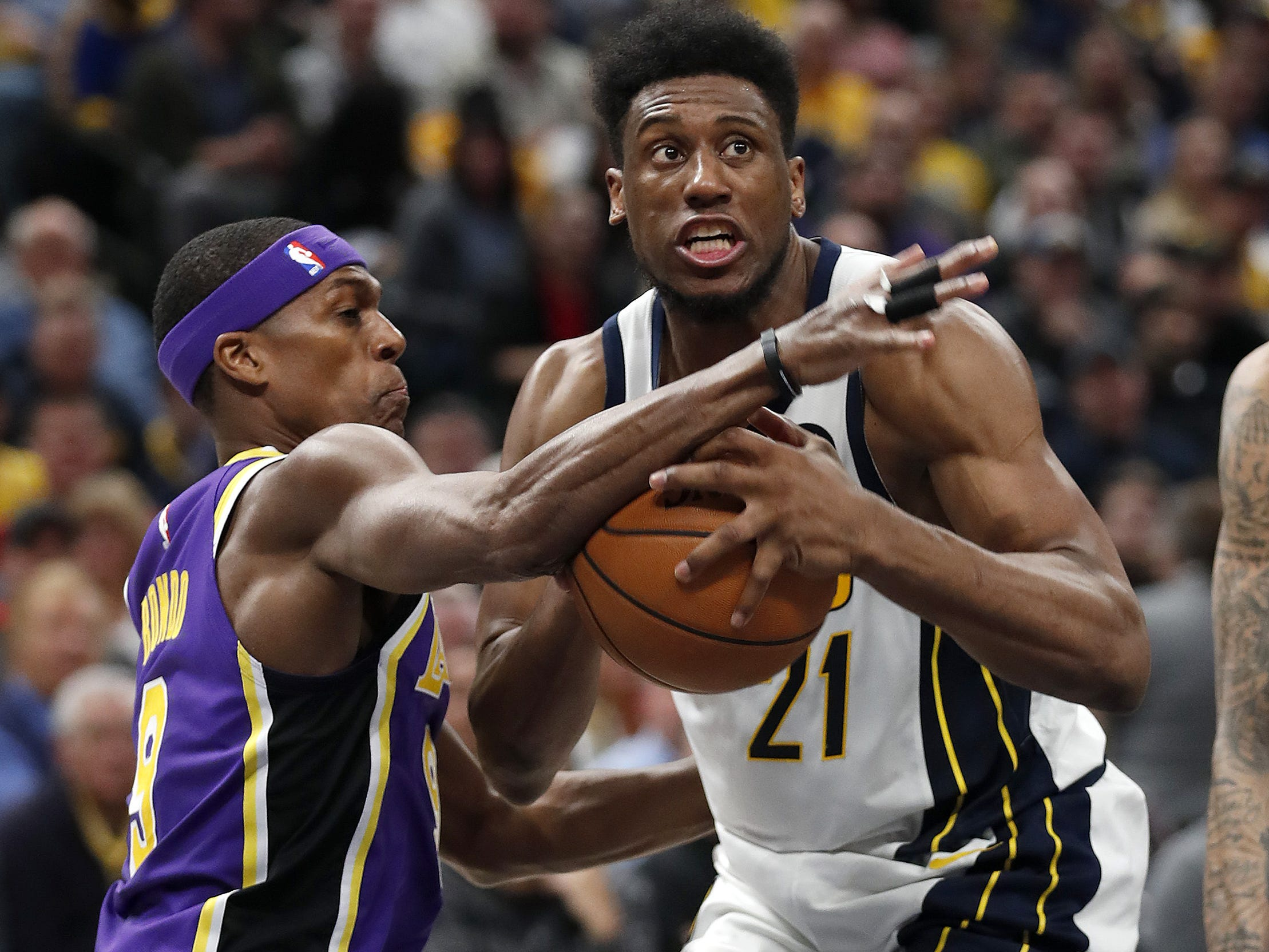 Indiana Pacers forward Thaddeus Young (21) drives on Los Angeles Lakers guard Rajon Rondo (9) in the first half of their game at Bankers Life Fieldouse on Tuesday, Feb. 5, 2019.