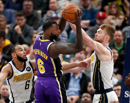 Los Angeles Lakers guard Lance Stephenson (6) looks to pass around Indiana Pacers forward Domantas Sabonis (11) in the second half of their game at Bankers Life Fieldhouse on Tuesday, Feb. 5, 2019.
