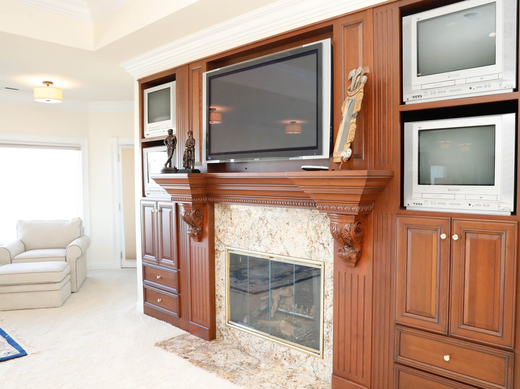 A second-floor master suite, one of two in the home, features a fireplace and five TVs, at a Greenwood home up for sale at 1216 Stone Ridge Court, Greenwood, Ind. on Wednesday, Jan. 30, 2019. The home features 8,234 square feet, four bedrooms, two master suites, a 10 car garage, and an exercise room.