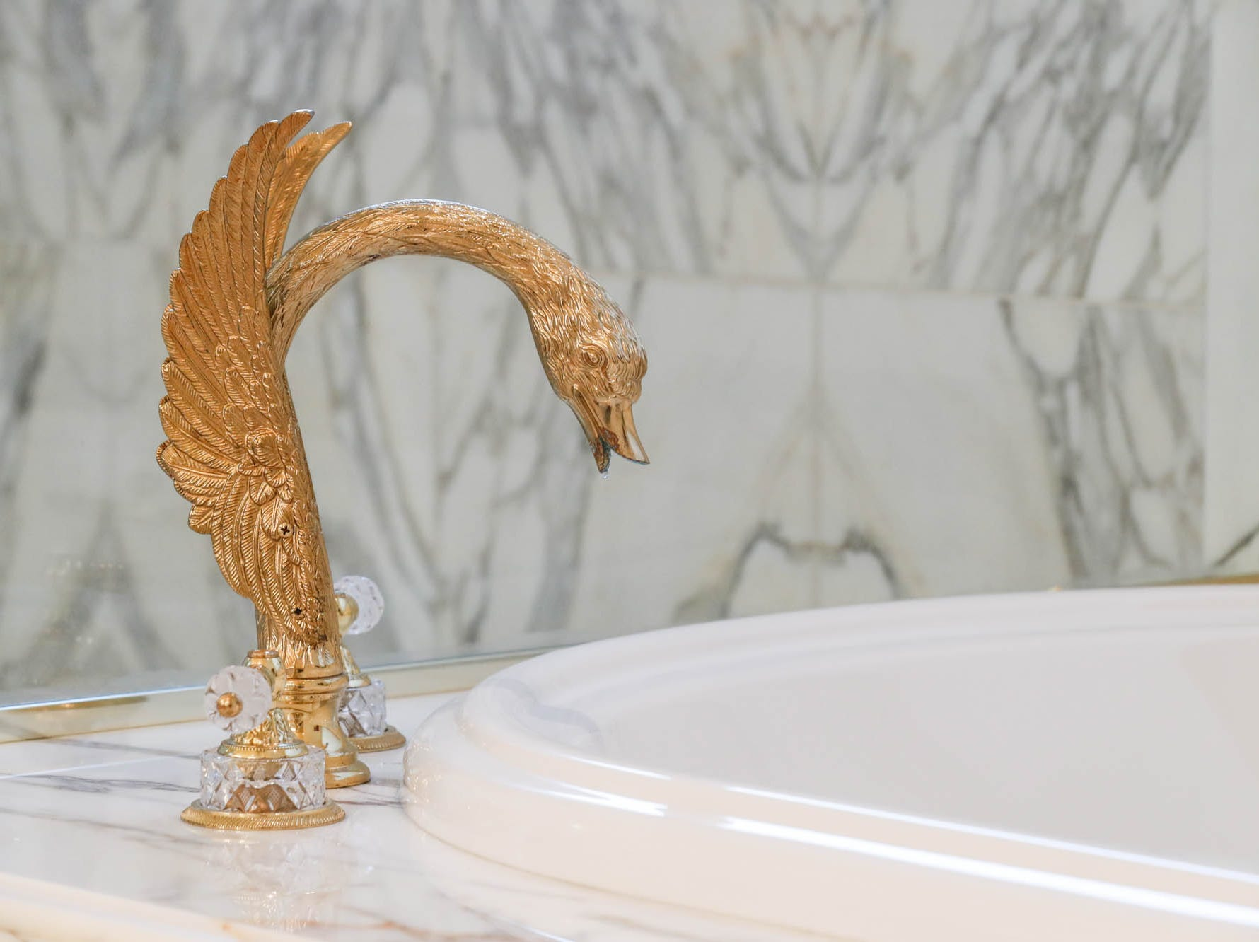 A first-floor master bath, one of two in the home, features a golden swan bath tap, a whirlpool tub, and all the storage space you could ask for, at a Greenwood home up for sale at 1216 Stone Ridge Court, Greenwood, Ind. on Wednesday, Jan. 30, 2019. The home features 8,234 square feet, four bedrooms, two master suites, a 10 car garage, and an exercise room.