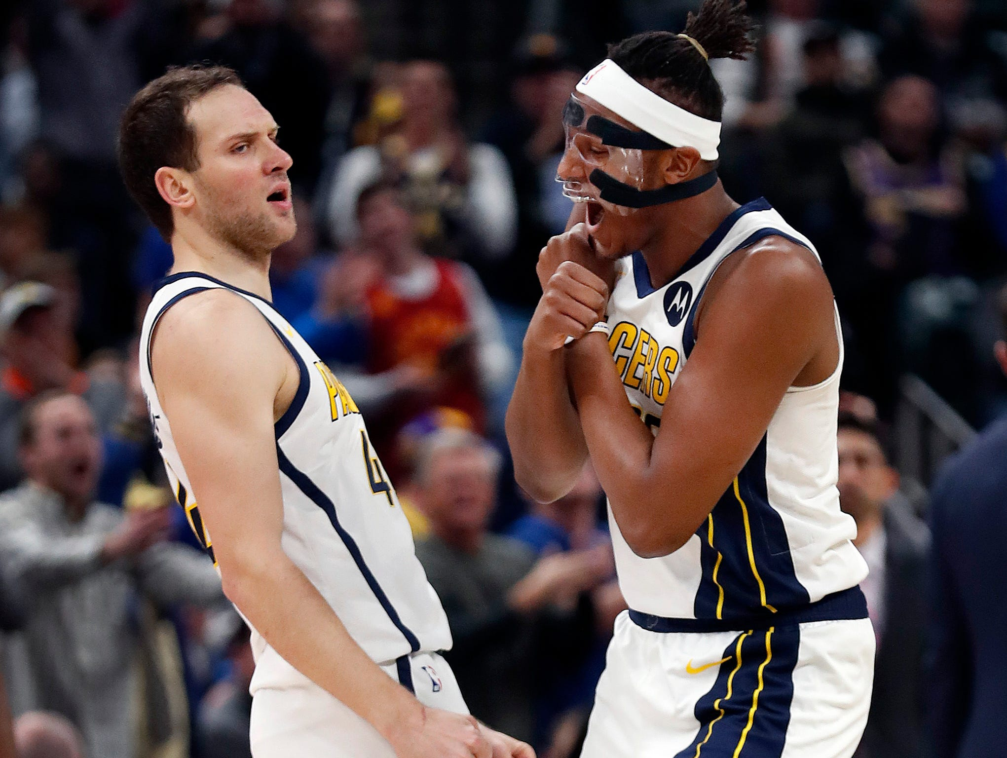 Indiana Pacers forward Bojan Bogdanovic (44) and Myles Turner (33) celebrate jumping out to a big leads over the Los Angeles Lakers in the first half of their game at Bankers Life Fieldhouse on Tuesday, Feb. 5, 2019.