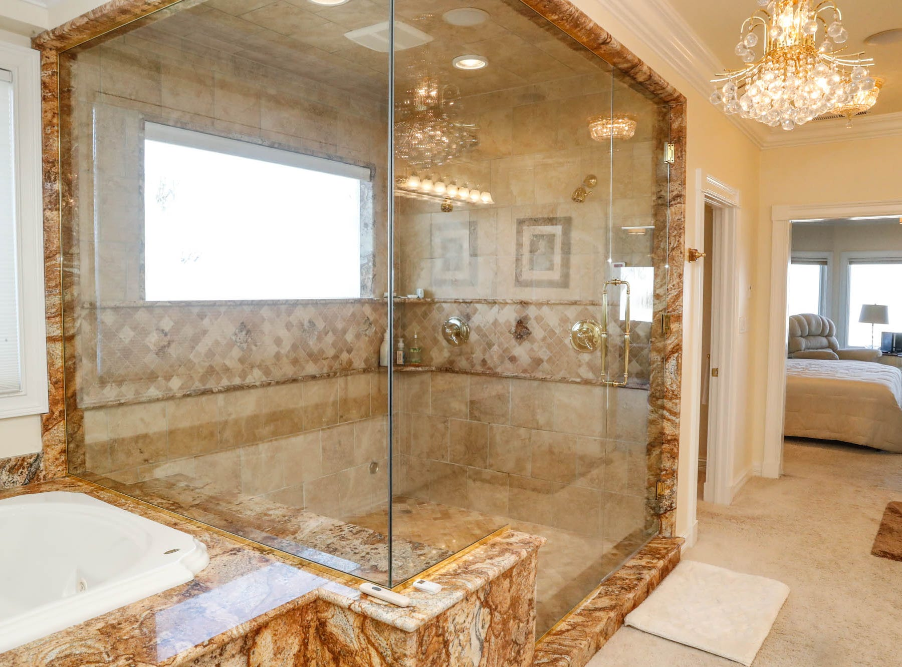 A second-floor master bath, one of two in the home, features the largest walk in shower, at a Greenwood home up for sale at 1216 Stone Ridge Court, Greenwood, Ind. on Wednesday, Jan. 30, 2019. The home features 8,234 square feet, four bedrooms, two master suites, a 10 car garage, and an exercise room.