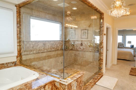 A second-floor master bath, one of two in the home, features the larger walk in shower.