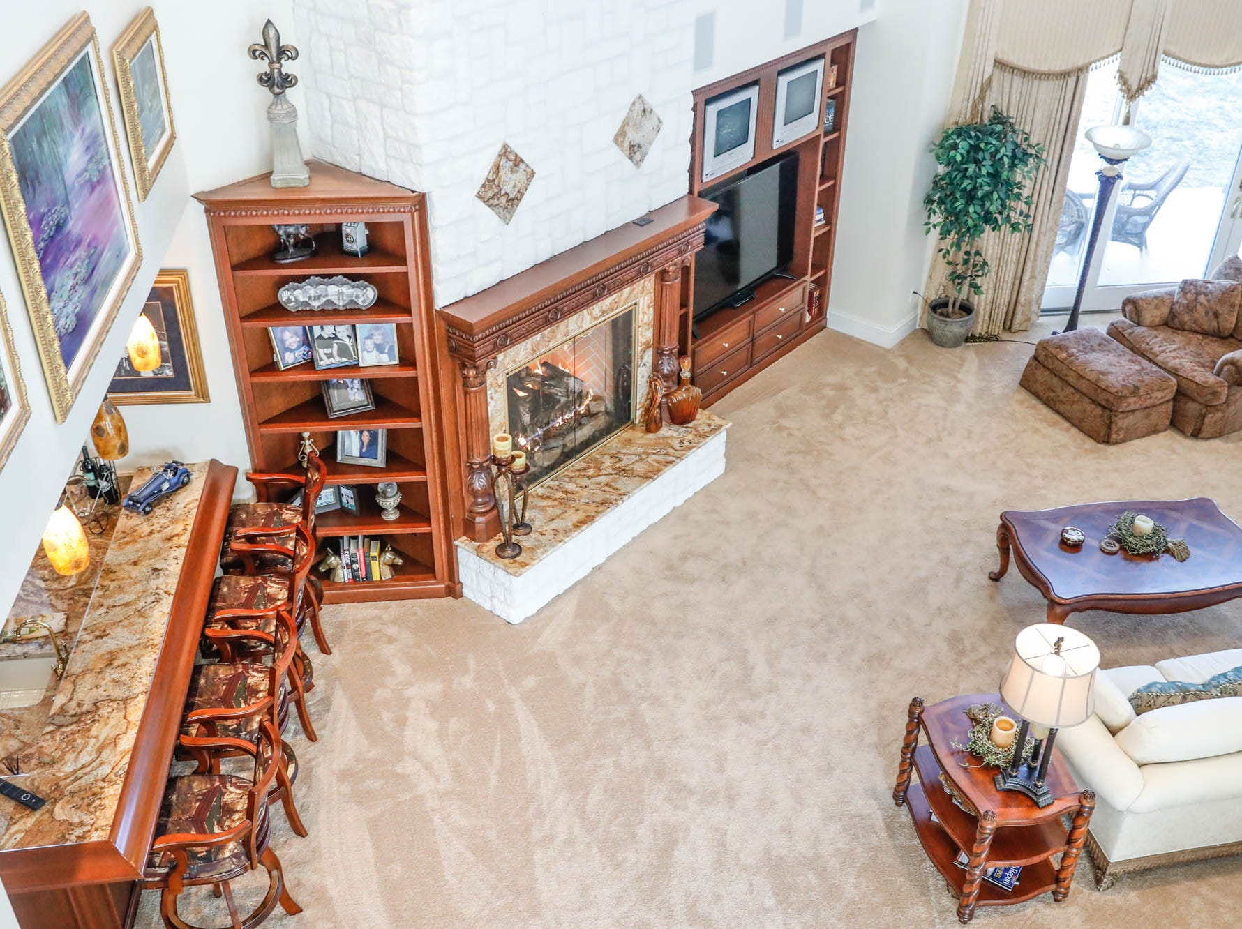 A loft provides a birds-eye view of an open floor plan living room at a Greenwood home up for sale at 1216 Stone Ridge Court, Greenwood, Ind. on Wednesday, Jan. 30, 2019. The home features 8,234 square feet, four bedrooms, two master suites, a 10 car garage, and an exercise room.