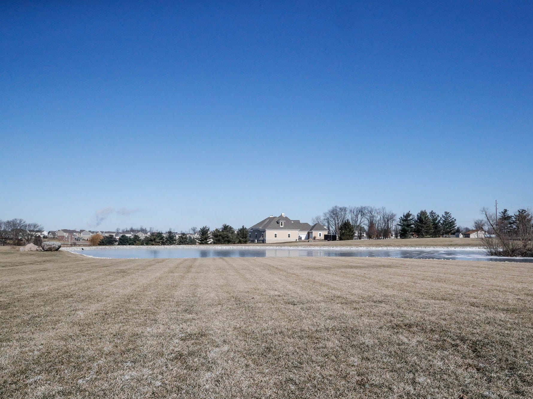 A stocked pond is located behind a Greenwood home up for sale at 1216 Stone Ridge Court, Greenwood, Ind. on Wednesday, Jan. 30, 2019. The home features 8,234 square feet, four bedrooms, two master suits, a 10 car garage, and exercise room.