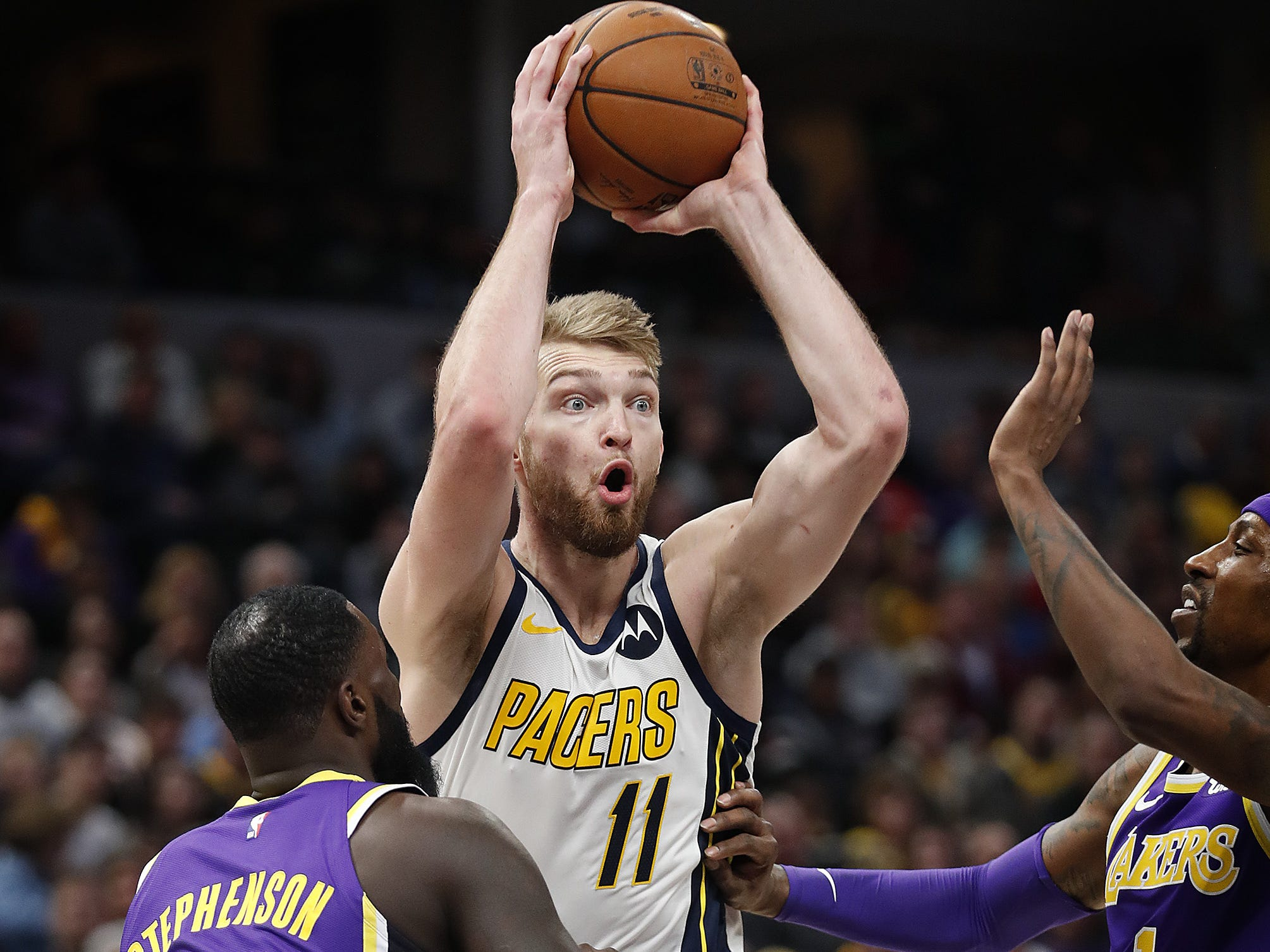 Indiana Pacers forward Domantas Sabonis (11) passes the ball over Los Angeles Lakers guard Lance Stephenson (6) in the second half of their game at Bankers Life Fieldhouse on Tuesday, Feb. 5, 2019.