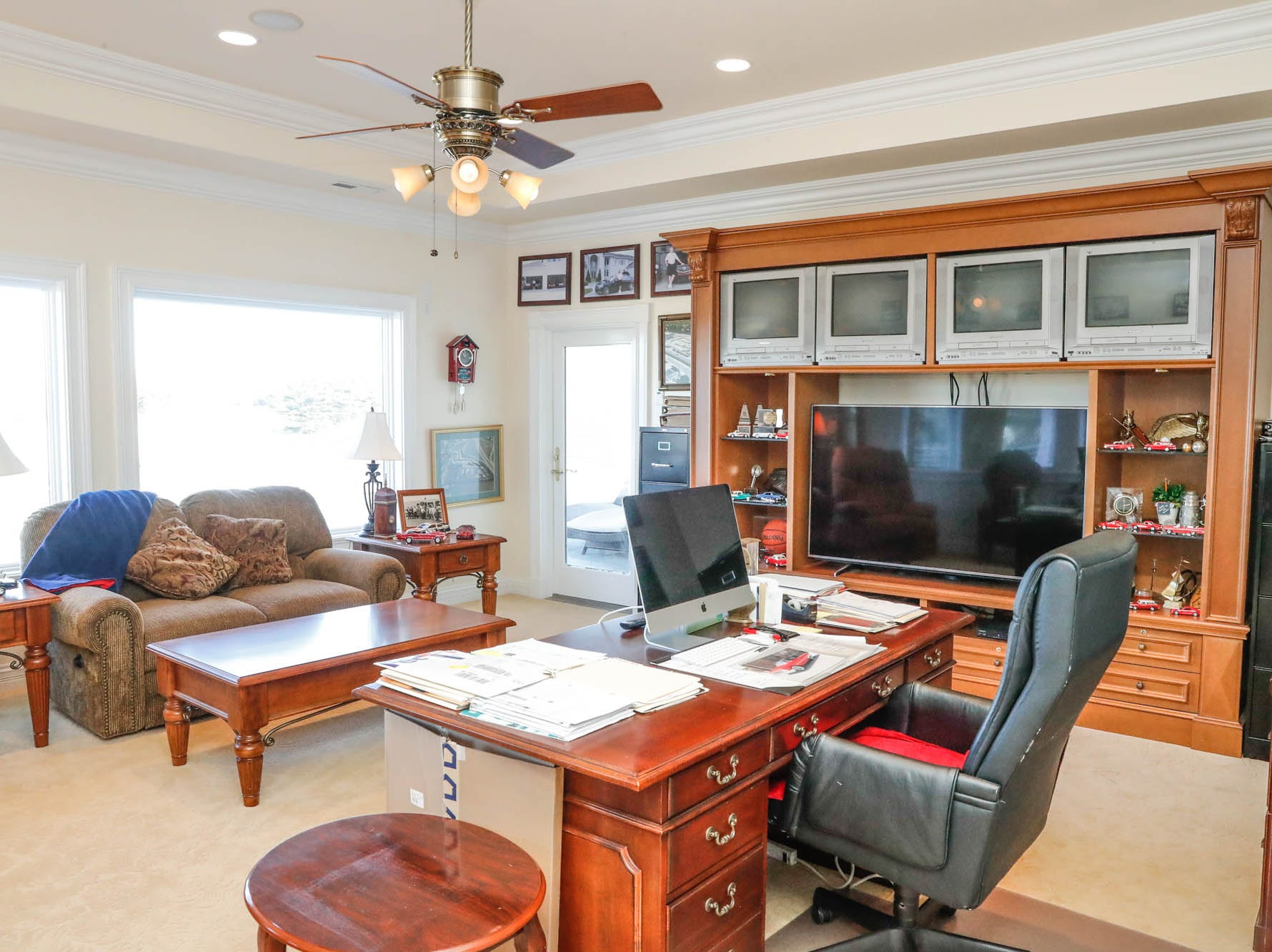 A second study/home office features a door to a large wrap around porch at a Greenwood home up for sale at 1216 Stone Ridge Court, Greenwood, Ind. on Wednesday, Jan. 30, 2019. The home features 8,234 square feet, four bedrooms, two master suites, a 10 car garage, and an exercise room.