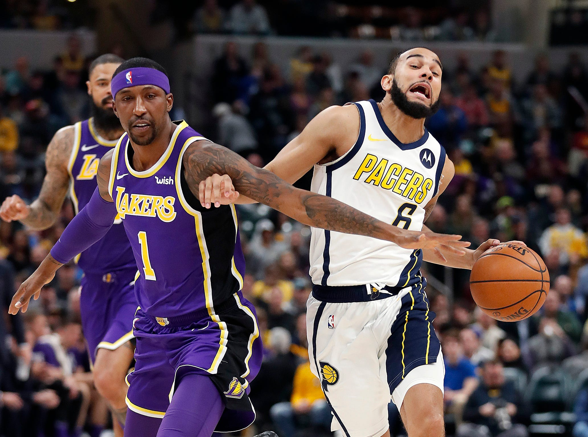 Indiana Pacers guard Cory Joseph (6) is fouled by Los Angeles Lakers guard Kentavious Caldwell-Pope (1) in the first half of their game at Bankers Life Fieldhouse on Tuesday, Feb. 5, 2019.