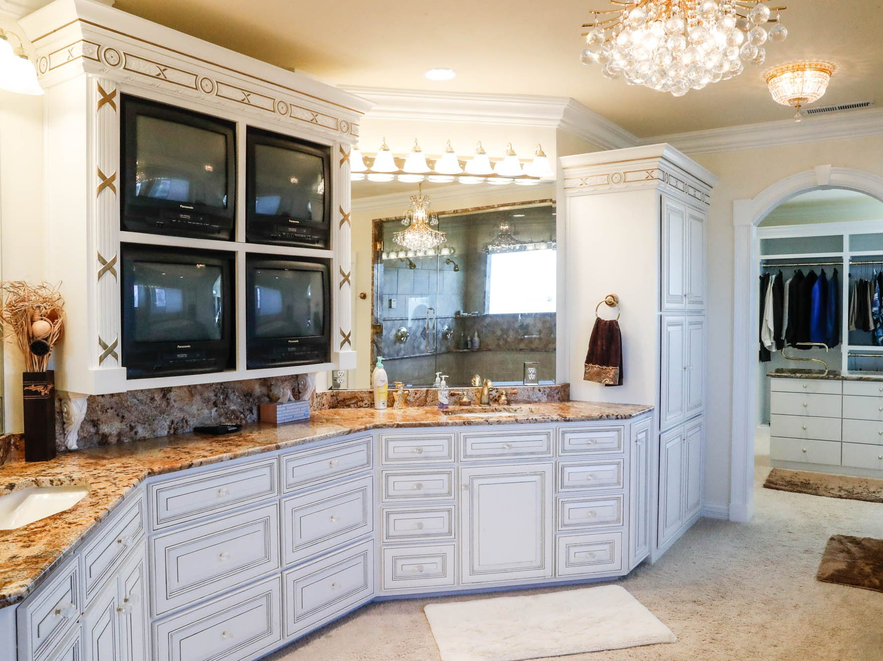 A second-floor master bath, one of two in the home, features four TV's, and all the space you could ever need, at a Greenwood home up for sale at 1216 Stone Ridge Court, Greenwood, Ind. on Wednesday, Jan. 30, 2019. The home features 8,234 square feet, four bedrooms, two master suites, a 10 car garage, and an exercise room.