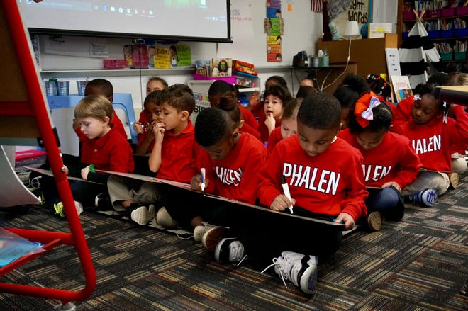 """First-graders at School 93 learn about the silent """"E."""" The school is run by the Phalen Leadership Academies charter network but is part of  Indianapolis Public Schools."""