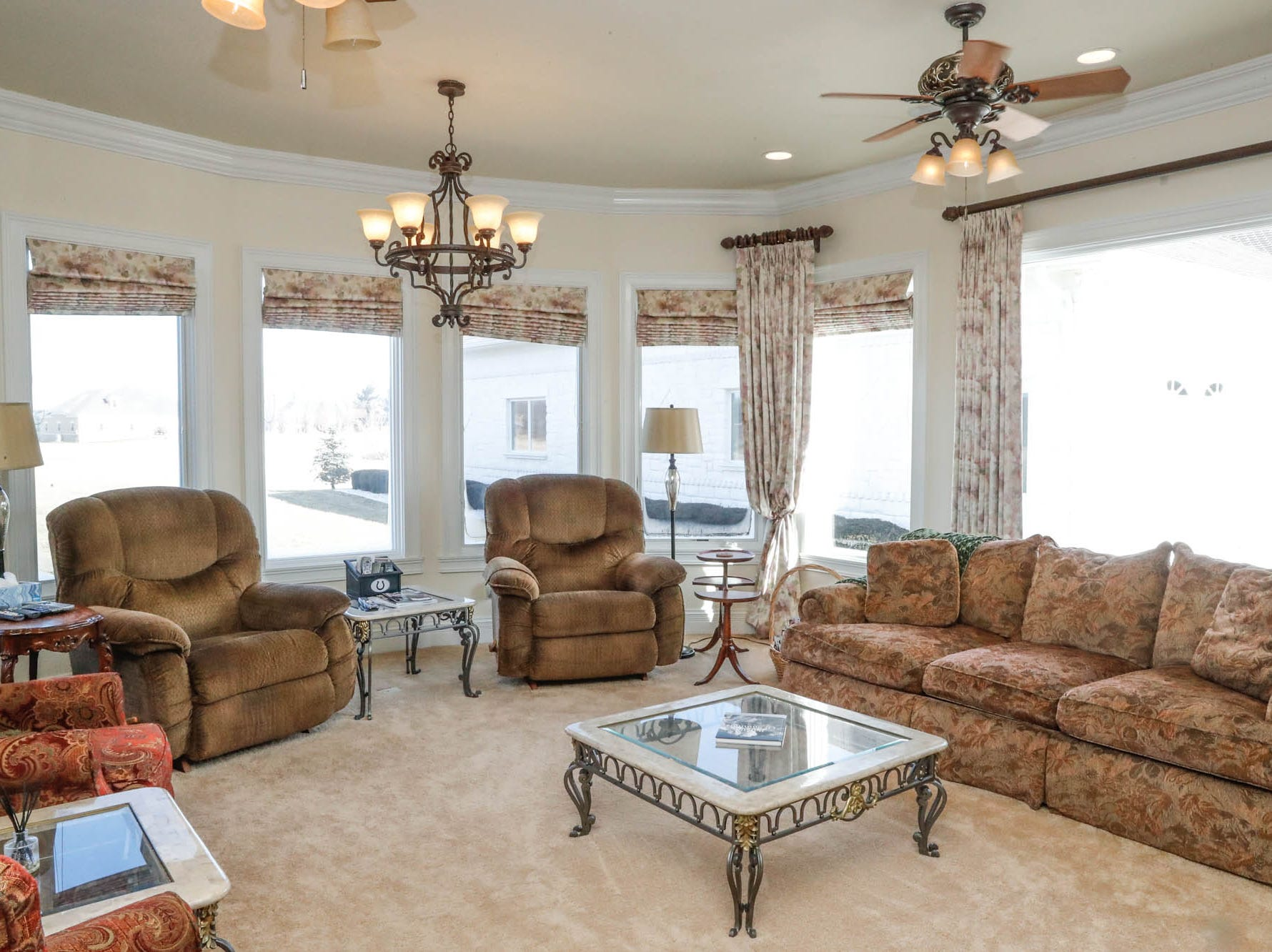 A theatre room offers a place to watch the game or have a movie night at a Greenwood home up for sale at 1216 Stone Ridge Court, Greenwood, Ind. on Wednesday, Jan. 30, 2019. The home features 8,234 square feet, four bedrooms, two master suits, a 10 car garage, and exercise room.