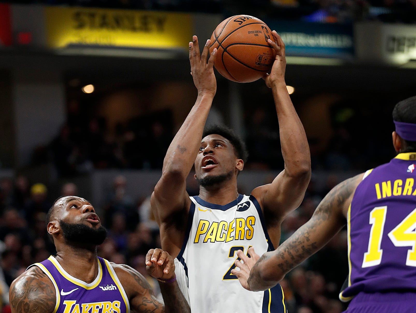 Indiana Pacers forward Thaddeus Young (21) drives on Los Angeles Lakers forward LeBron James (23) in the first half of their game at Bankers Life Fieldhouse on Tuesday, Feb. 5, 2019.