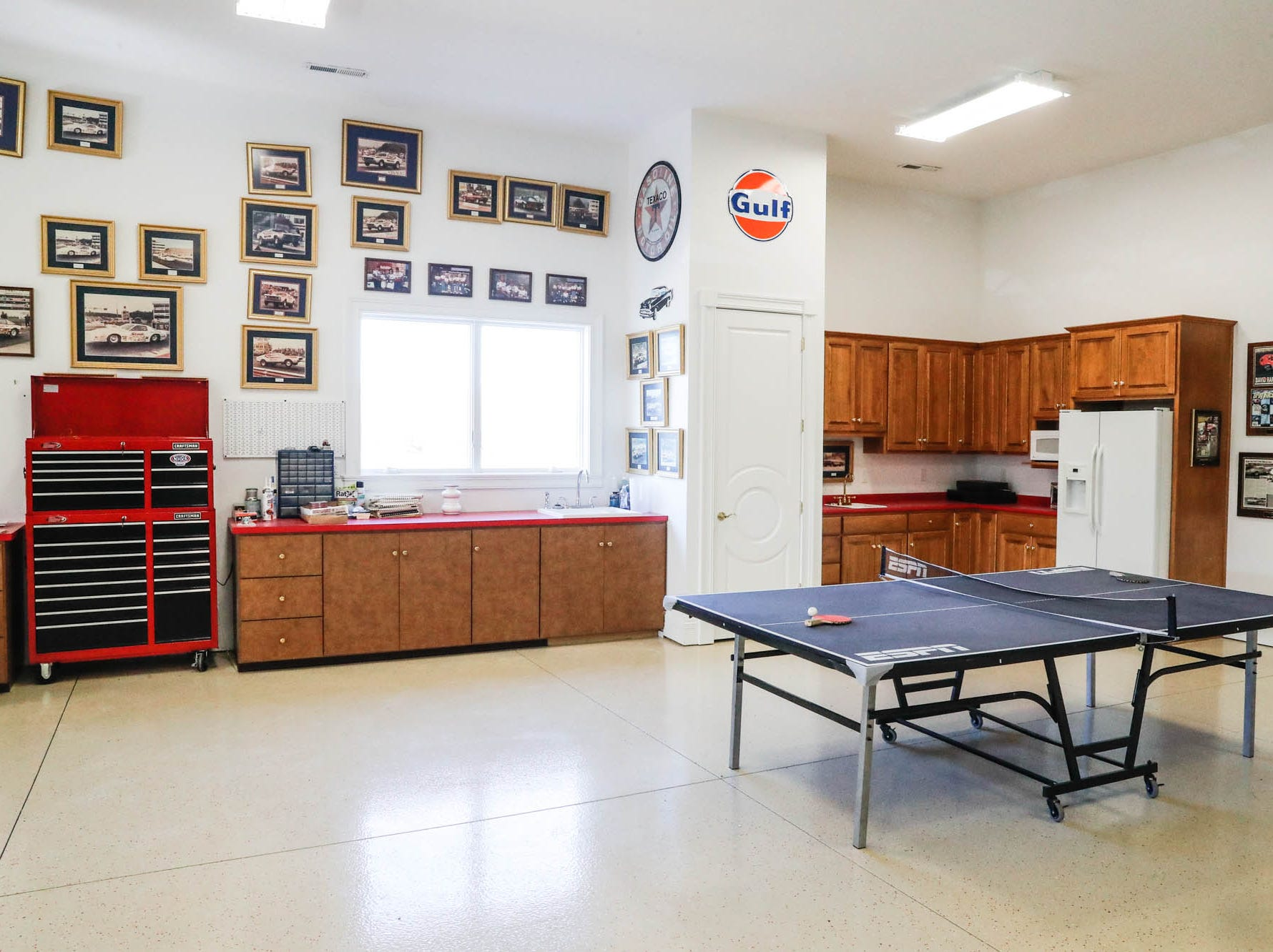 An unattached garage with kitchenette, has room for a fleet of cars and a motorhome, at a Greenwood home up for sale at 1216 Stone Ridge Court, Greenwood, Ind. on Wednesday, Jan. 30, 2019. The home features 8,234 square feet, four bedrooms, two master suites, a 10 car garage, and an exercise room.