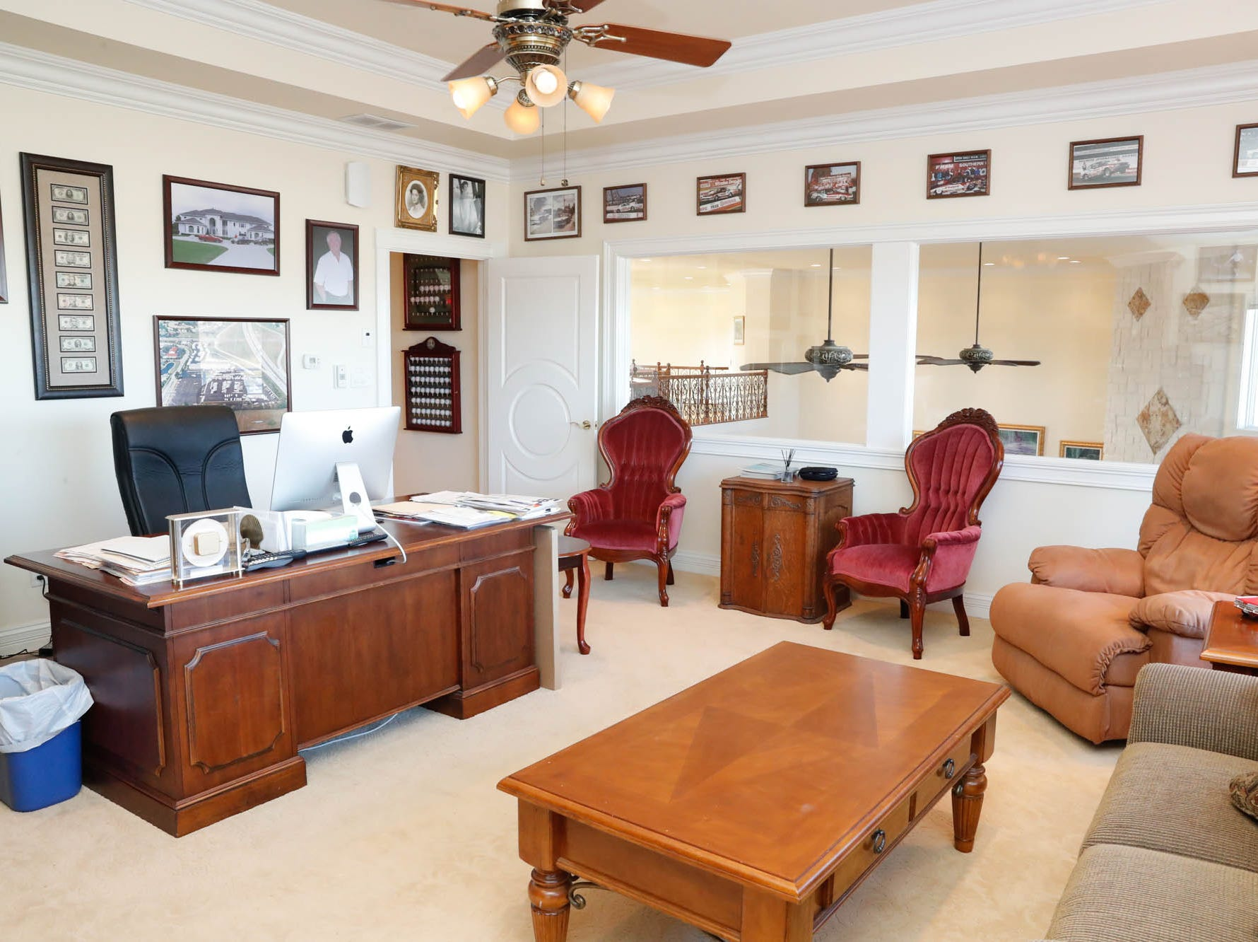 A second study/home office features a door to a large wrap around porch and windows overlooking an open plan living room at a Greenwood home up for sale at 1216 Stone Ridge Court, Greenwood, Ind. on Wednesday, Jan. 30, 2019. The home features 8,234 square feet, four bedrooms, two master suites, a 10 car garage, and an exercise room.