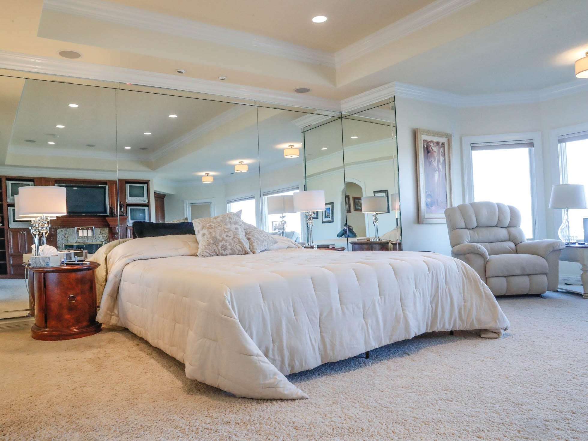A second-floor master suite, one of two in the home, features mirrored walls and a seating area at a Greenwood home up for sale at 1216 Stone Ridge Court, Greenwood, Ind. on Wednesday, Jan. 30, 2019. The home features 8,234 square feet, four bedrooms, two master suites, a 10 car garage, and an exercise room.