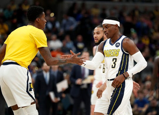 Indiana Pacers guard Aaron Holiday (3) and Edmond Sumner (5), left, begin to celebrate in the first half of their game at Bankers Life Fieldhouse on Tuesday, Feb. 5, 2019.