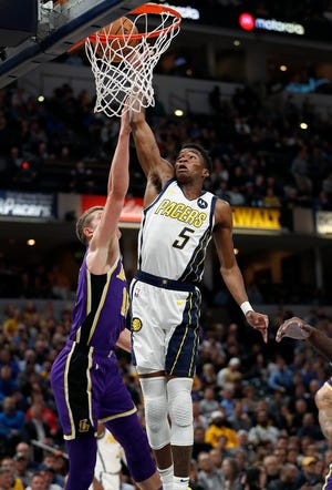 Indiana Pacers guard Edmond Sumner (5) drives on Los Angeles Lakers center Moritz Wagner (15) in the second half of their game at Bankers Life Fieldhouse on Tuesday, Feb. 5, 2019.