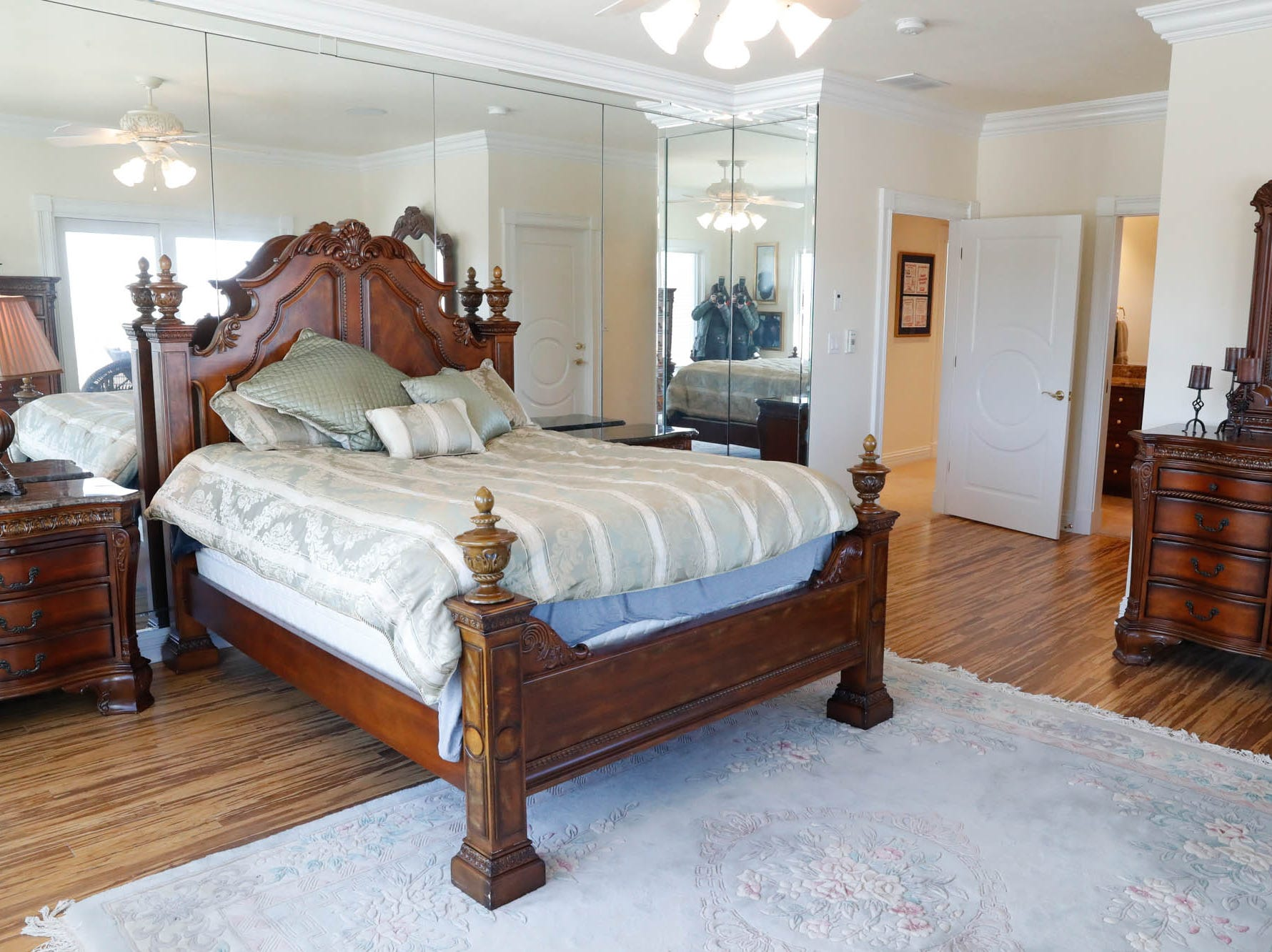 A bedroom features mirrored walls at a Greenwood home up for sale at 1216 Stone Ridge Court, Greenwood, Ind. on Wednesday, Jan. 30, 2019. The home features 8,234 square feet, four bedrooms, two master suites, a 10 car garage, and an exercise room.