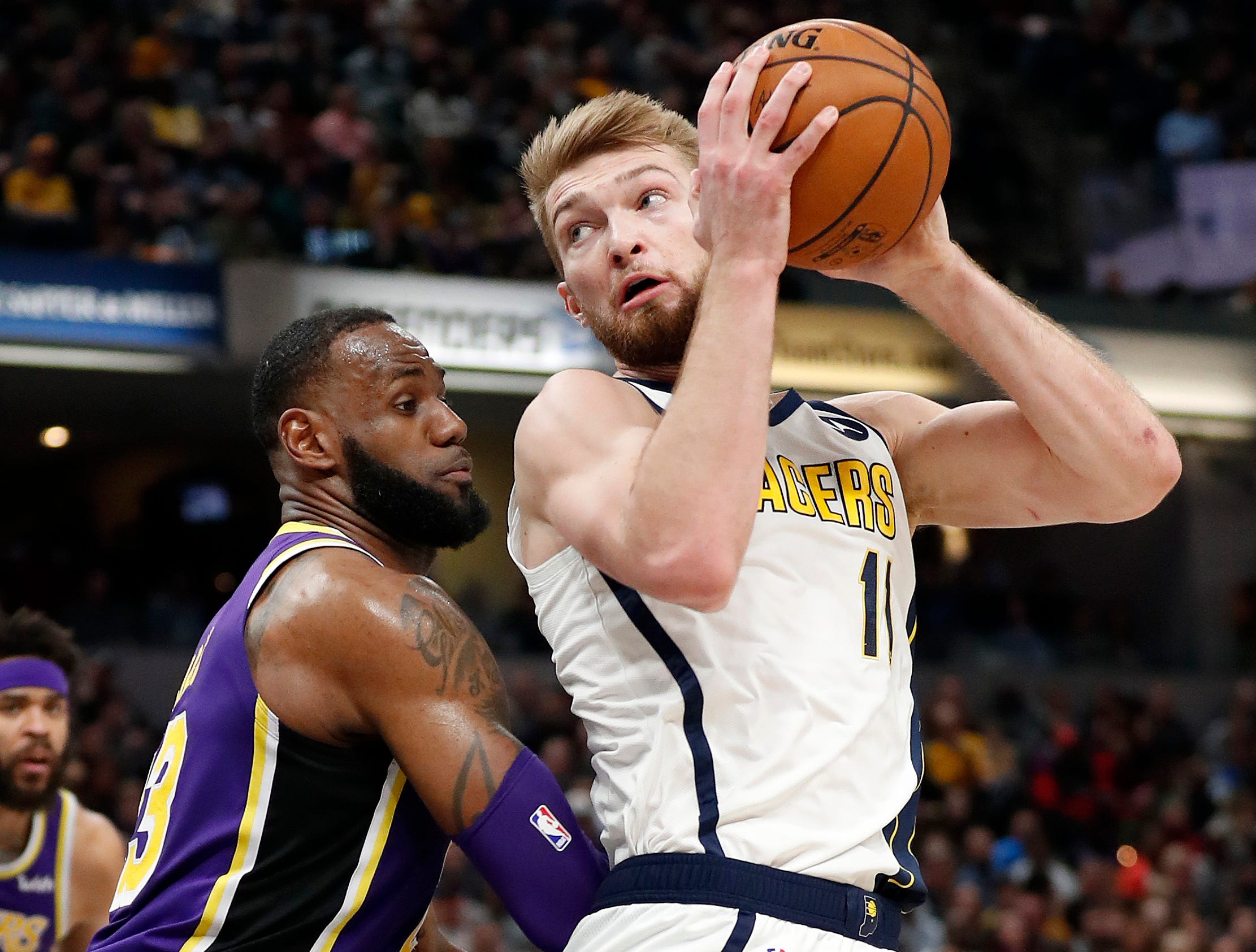 Indiana Pacers forward Domantas Sabonis (11) spins on Los Angeles Lakers forward LeBron James (23) in the first half of their game at Bankers Life Fieldhouse on Tuesday, Feb. 5, 2019.