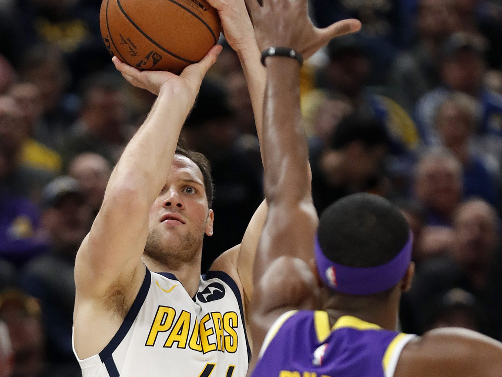 Indiana Pacers forward Bojan Bogdanovic (44) shoots a three-pointer over Los Angeles Lakers guard Rajon Rondo (9) in the first half of their game at Bankers Life Fieldouse on Tuesday, Feb. 5, 2019.