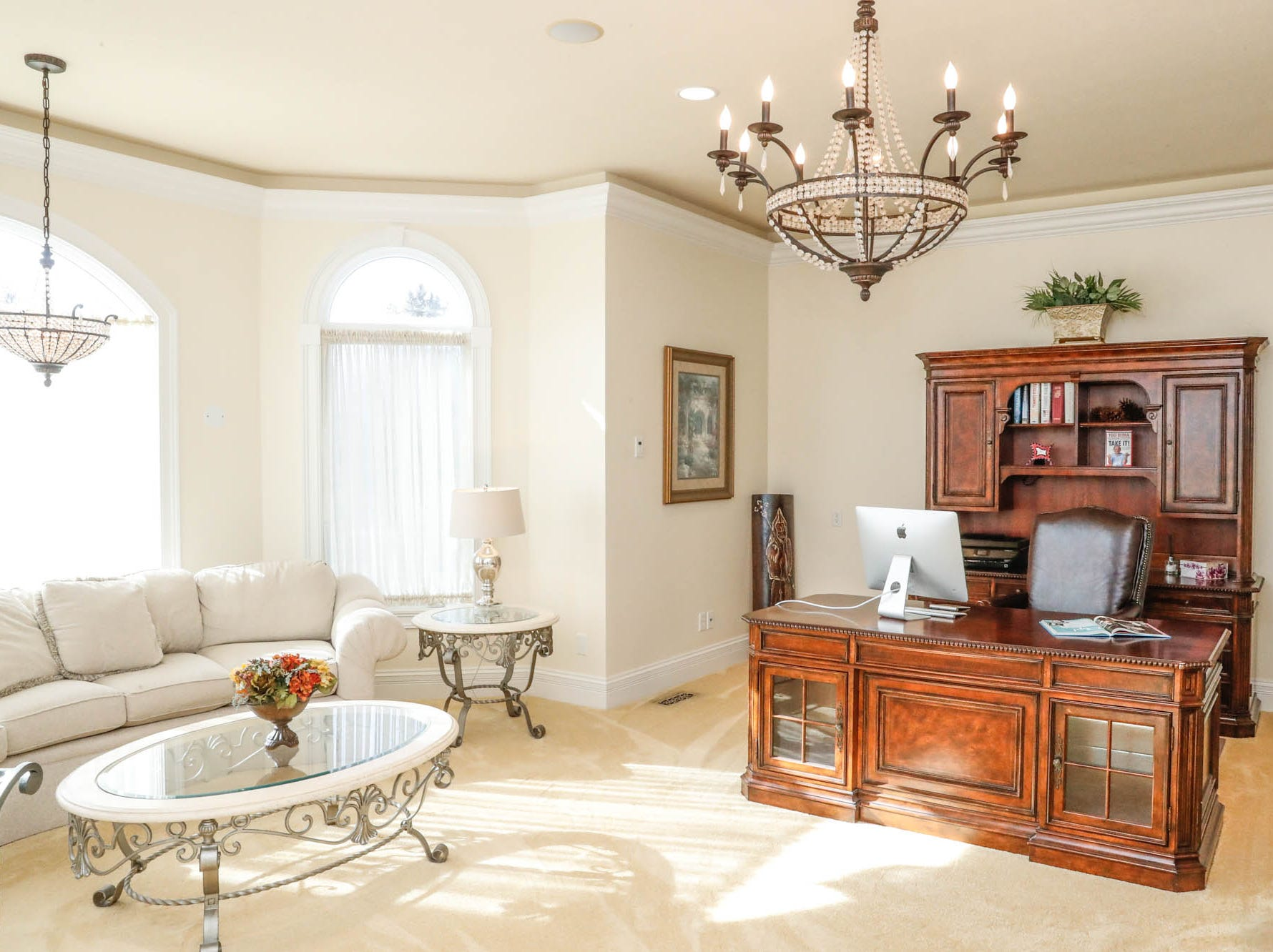 A bright study/home office offers a homeowner plenty of room to work at a Greenwood home up for sale at 1216 Stone Ridge Court, Greenwood, Ind. on Wednesday, Jan. 30, 2019. The home features 8,234 square feet, four bedrooms, two master suites, a 10 car garage, and an exercise room.