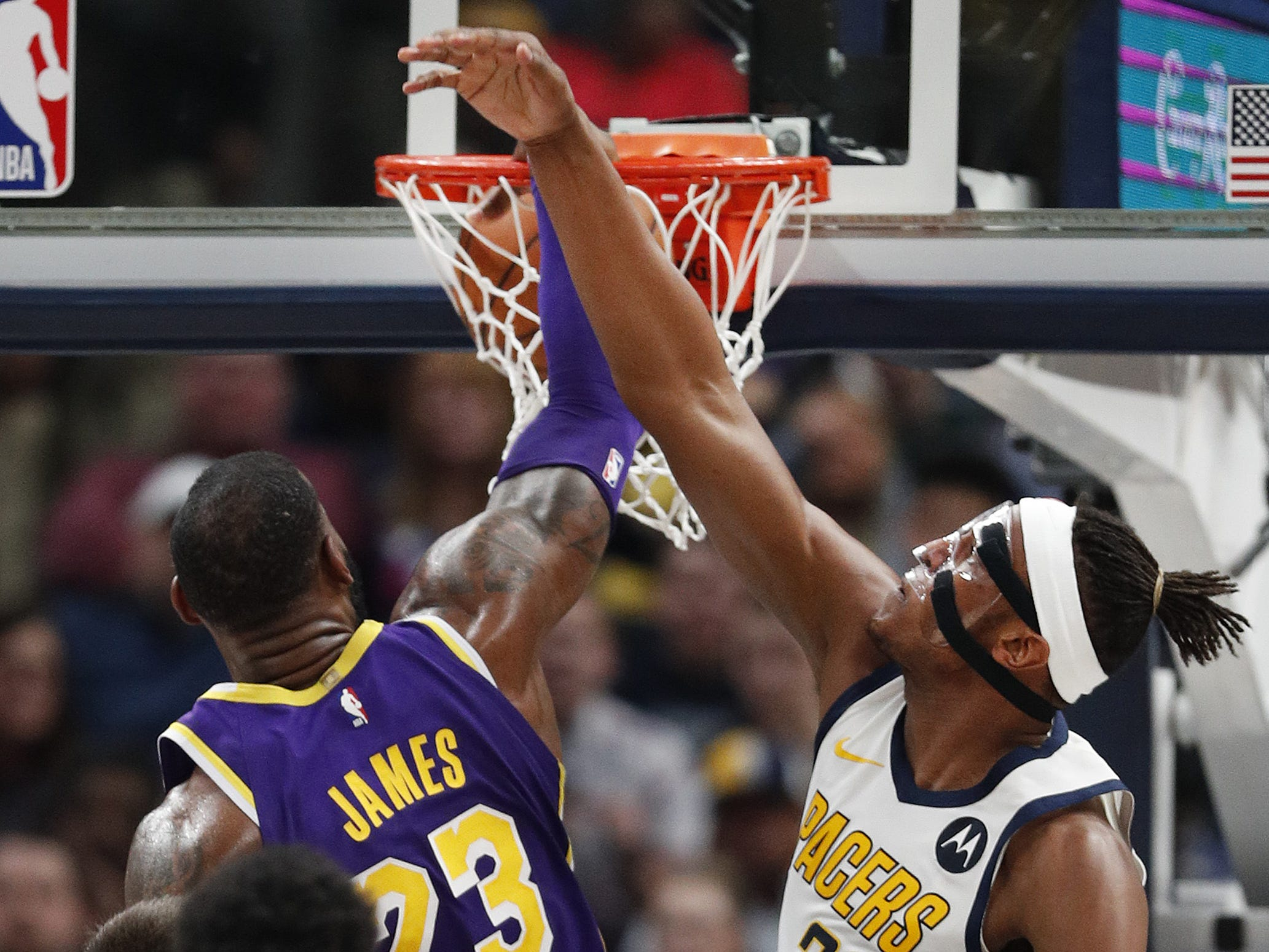Los Angeles Lakers forward LeBron James (23) dunks on Indiana Pacers center Myles Turner (33) in the first half of their game at Bankers Life Fieldouse on Tuesday, Feb. 5, 2019.