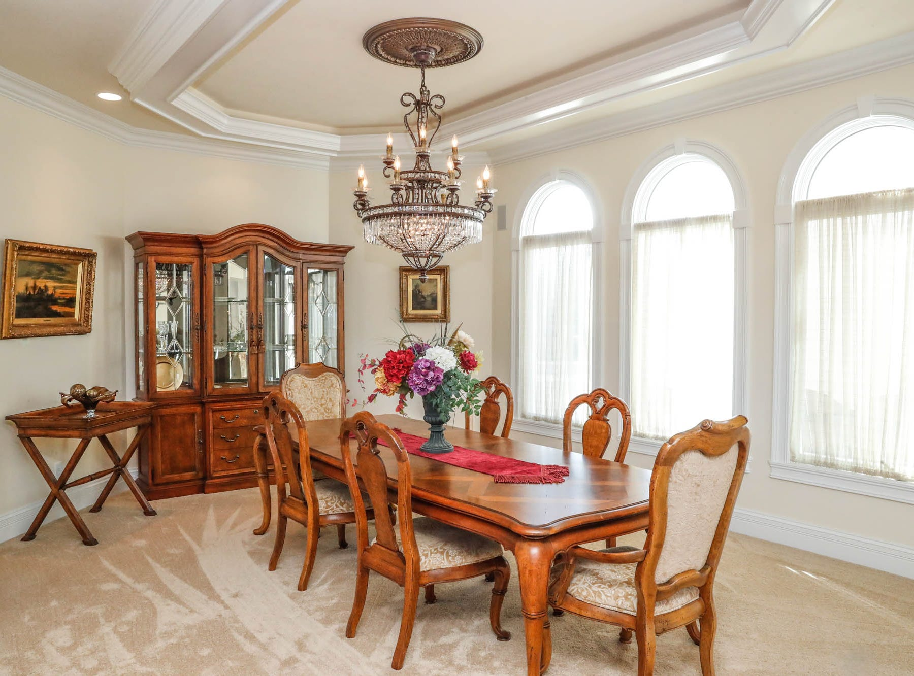 A dining room features large windows and crown molding, at a Greenwood home up for sale at 1216 Stone Ridge Court, Greenwood, Ind. on Wednesday, Jan. 30, 2019. The home features 8,234 square feet, four bedrooms, two master suits, a 10 car garage, and exercise room.