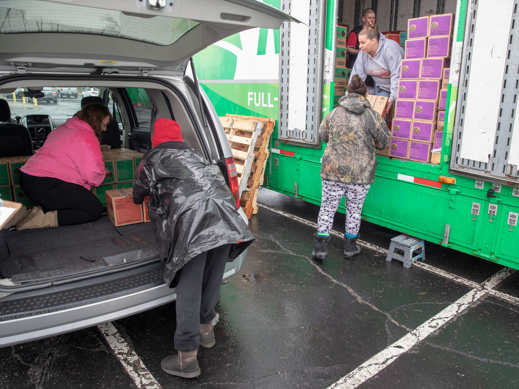A car is loaded during distribution for Girl Scout Cookies in Indianapolis, Wednesday, Feb. 6, 2019. The cookies will start to appear locally on the weekend, and should last into mid-March.