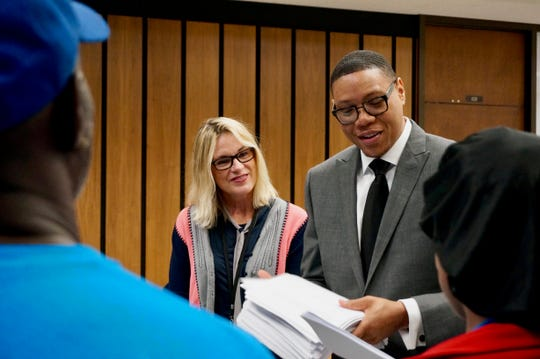 Indianapolis Public Schools board President Mary Ann Sullivan and former Superintendent Lewis Ferebee accept emails in support of the district's high school reconfiguration plan from parents with Stand for Children Indiana on Sept. 18, 2017.