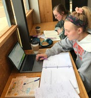 Millsaps College seniors Grace Bellnap and Kayleigh Aicklen study at Cross Prose coffee and books.