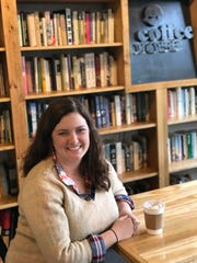 Emily Pote, co-owner and operator of Coffee Prose, loves all of the used books the coffee shop features.