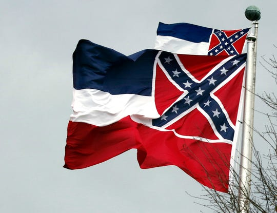 Two Mississippi state flags wave outside the Capitol in Jackson, Miss., in this Jan. 22, 2019, photograph.