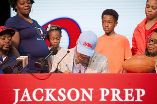 Jackson Prep's Jerrion Ealy is surrounded by family as he signs with Ole Miss during Signing Day at the school Friday, Feb. 6, 2019.