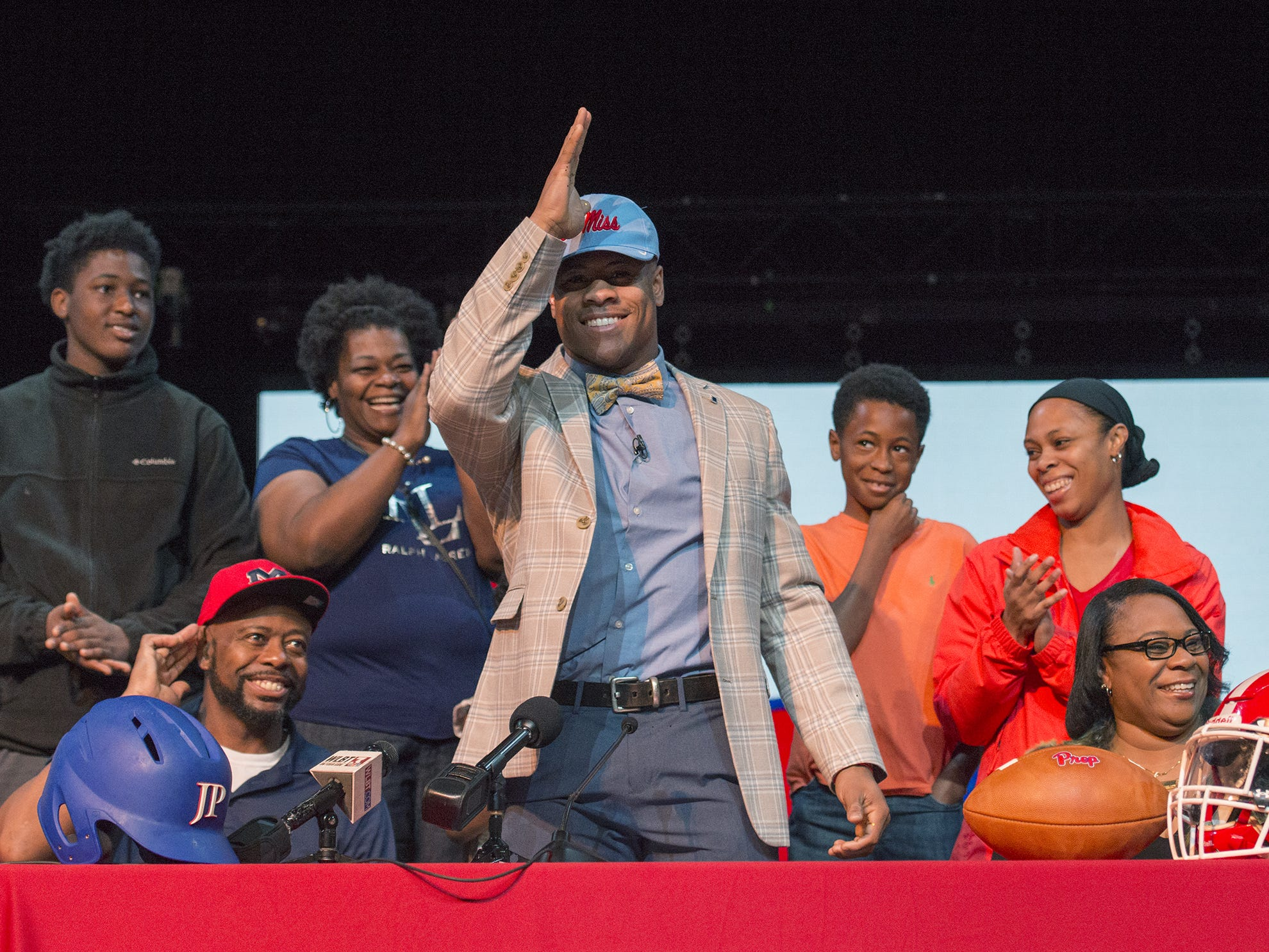 Jackson Prep's 5-star running back and two-sport standout Jerrion Ealy makes a Landshark gesture after signing to play for Ole Miss during National Signing Day at the school Friday, Feb. 6, 2019.