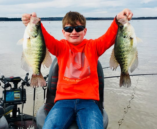 Wyatt Krutz, 9, of Brandon holds a couple of the quality crappie that are being caught in Barnett Reservoir recently.